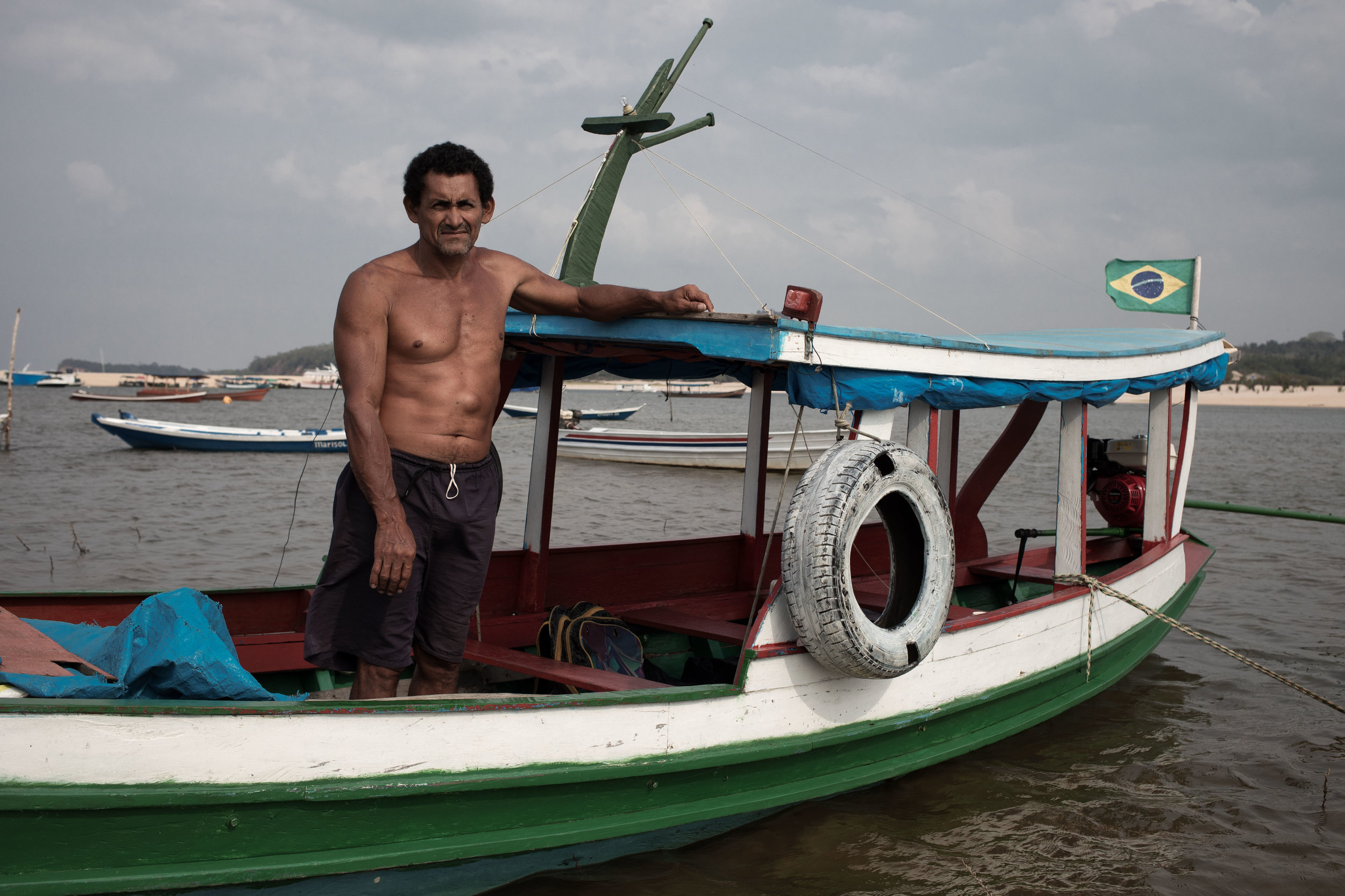 A man stands on his boat in Alter do chão, Brazil.