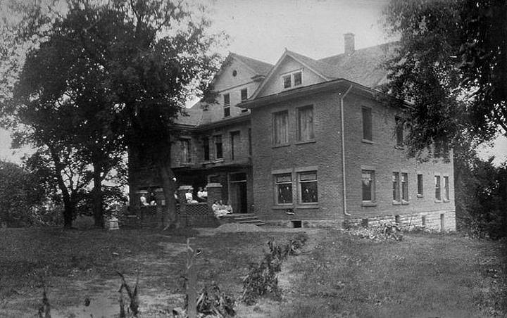 Very early undated photo of Edgewood.  The building was constructed in 1909 and it is evident that this image shows a work-in-progress. The sidewalks are not completed.   Scanned by Rich Gaulke, December 18, 2014, from the collection of the Iowa Falls Historical Society at the Dow House,Sue Crotty, photo curator.