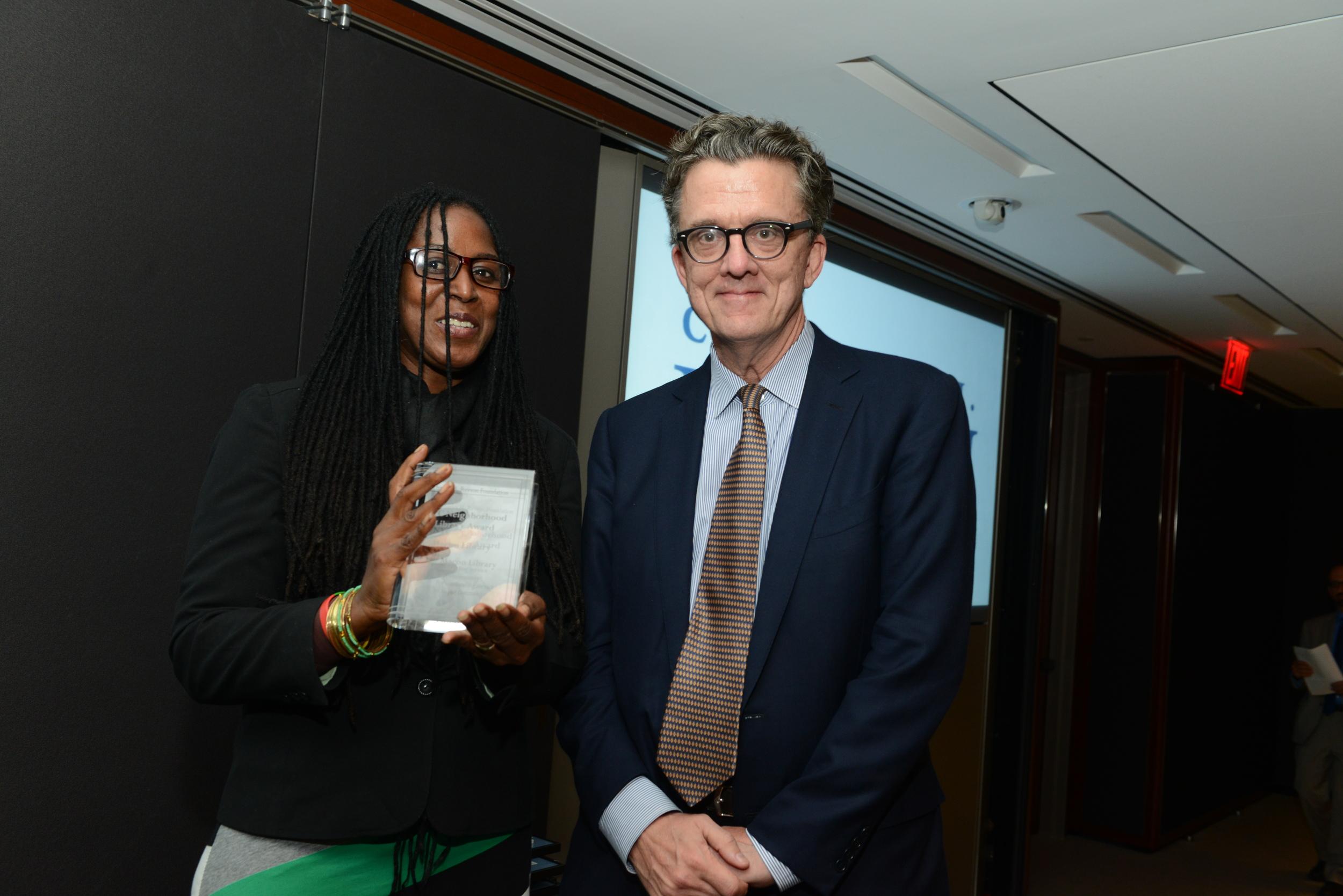Macon Library accepts its award from Judge Kurt Andersen