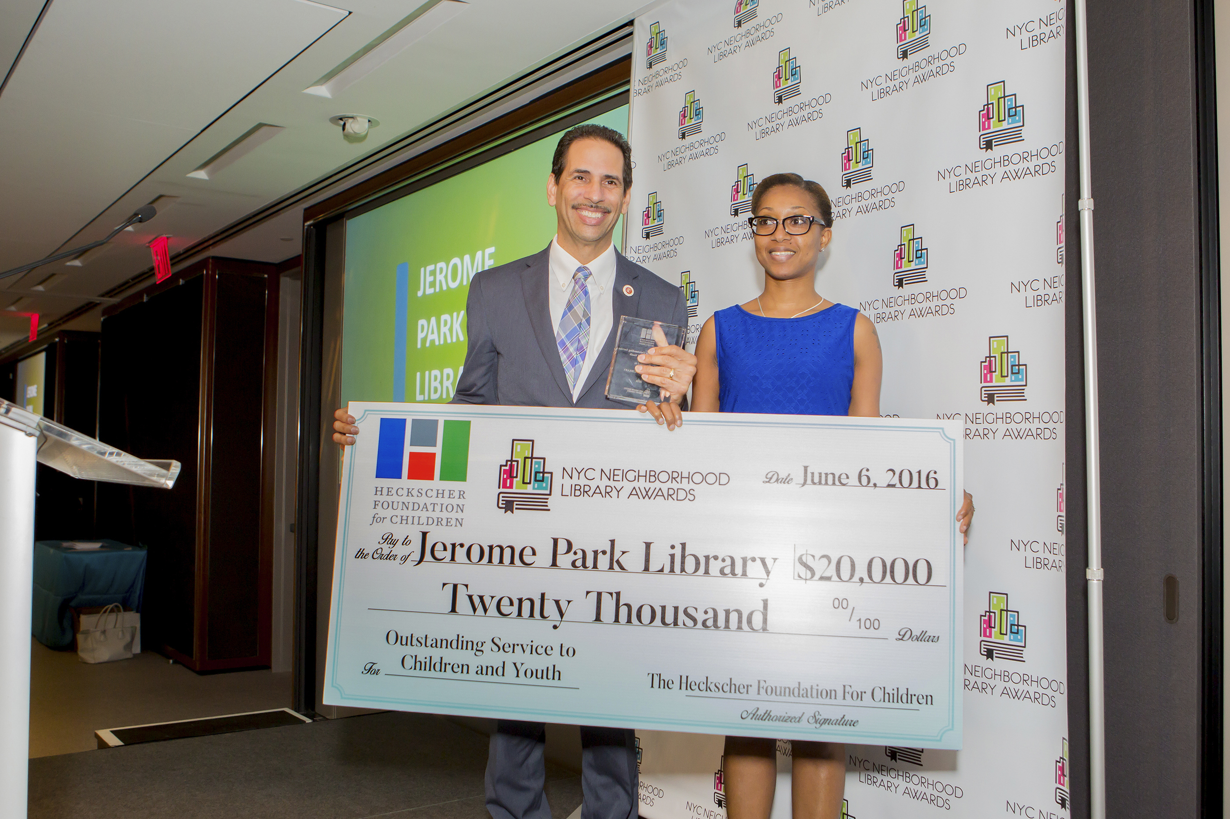 Council Member Fernando Cabrera presents the Heckscher Prize for Outstanding Service to Children and Youth to Nicola McDonald, Manager of the Jerome Park Library