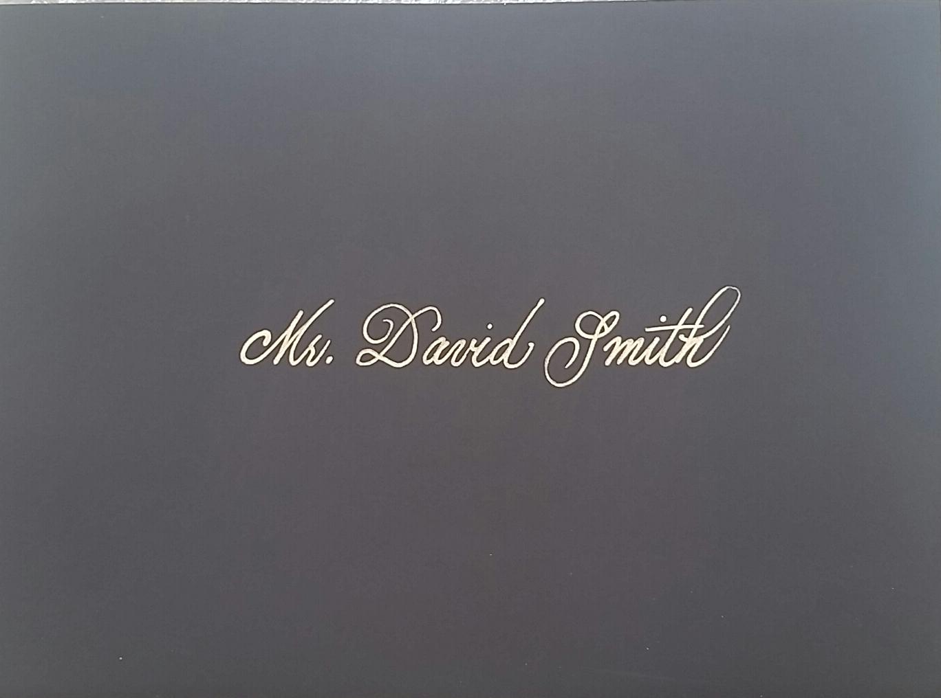 Gold on black envelope.jpg
