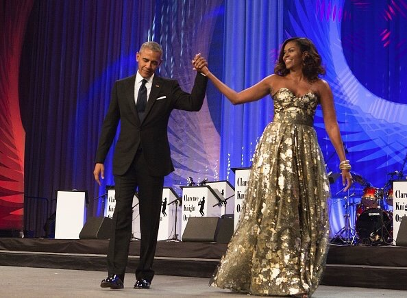 First-Lady-Michelle-Obama-Wears-Naeem-Khan-Gold-Strapless-Gown-to-the-Phoenix-Awards-Dinner.jpg