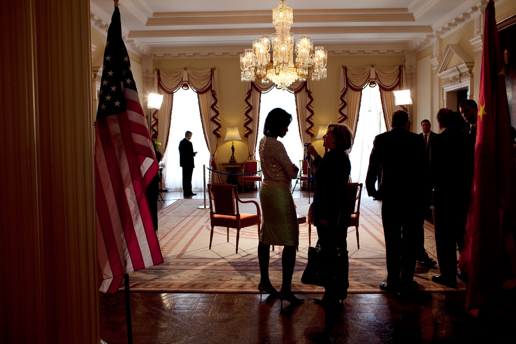 Michelle Obama talks alone with Secretary of State Hillary Rodham Clinton prior to President Obama's Meeting with President Hu of China. Winfield House in London, England, April 1, 2009.jpg