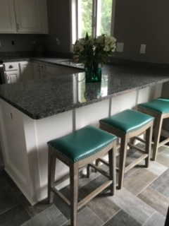 New flooring, freshly painted cabinetry, new counter tops + stools