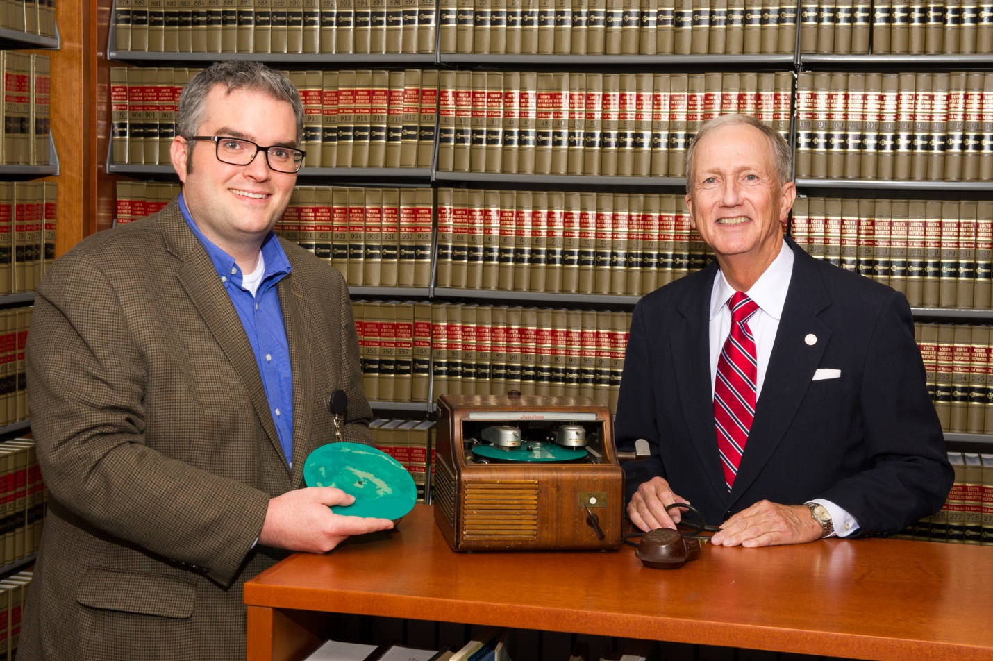 Law Library Deputy Director Joseph Lawson and Harris County Attorney Vince Ryan with a 1940s soundscriber machine.