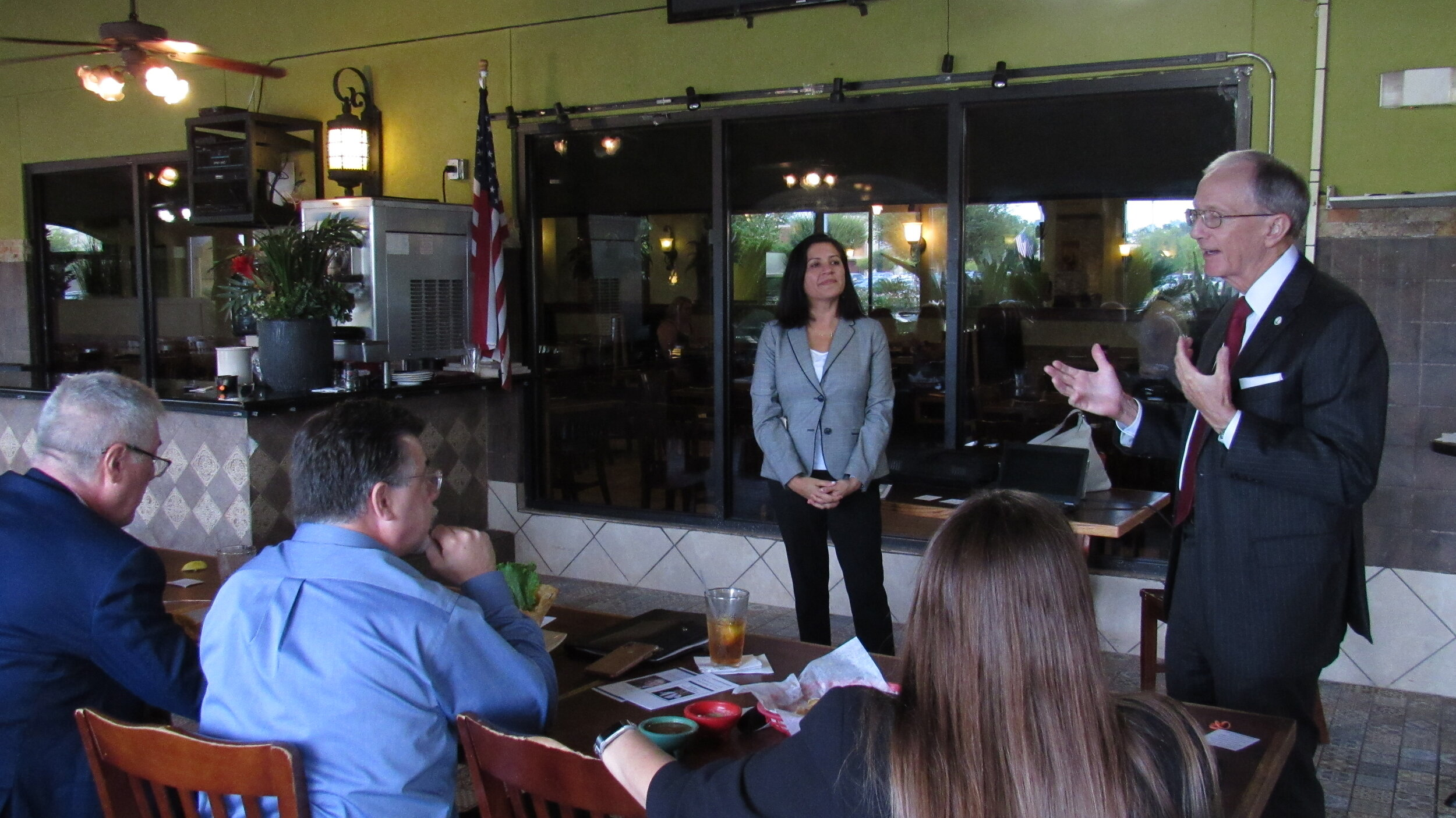 Celina Vinson, managing attorney for litigation (left), and County Attorney Vince Ryan discuss community protection matters with the Northeast Harris County Bar Association on Sept. 13.