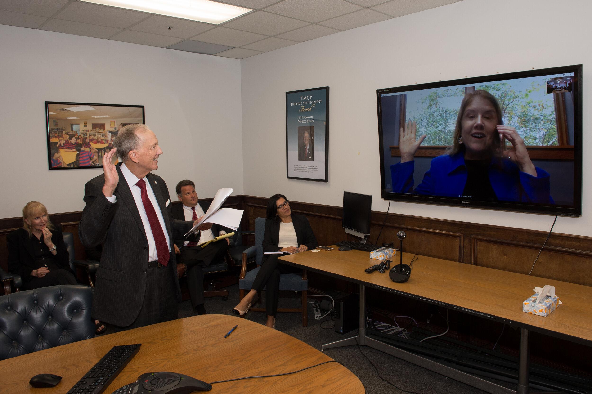 County Attorney Vince Ryan swears in Clarissa Bauer via Skype.