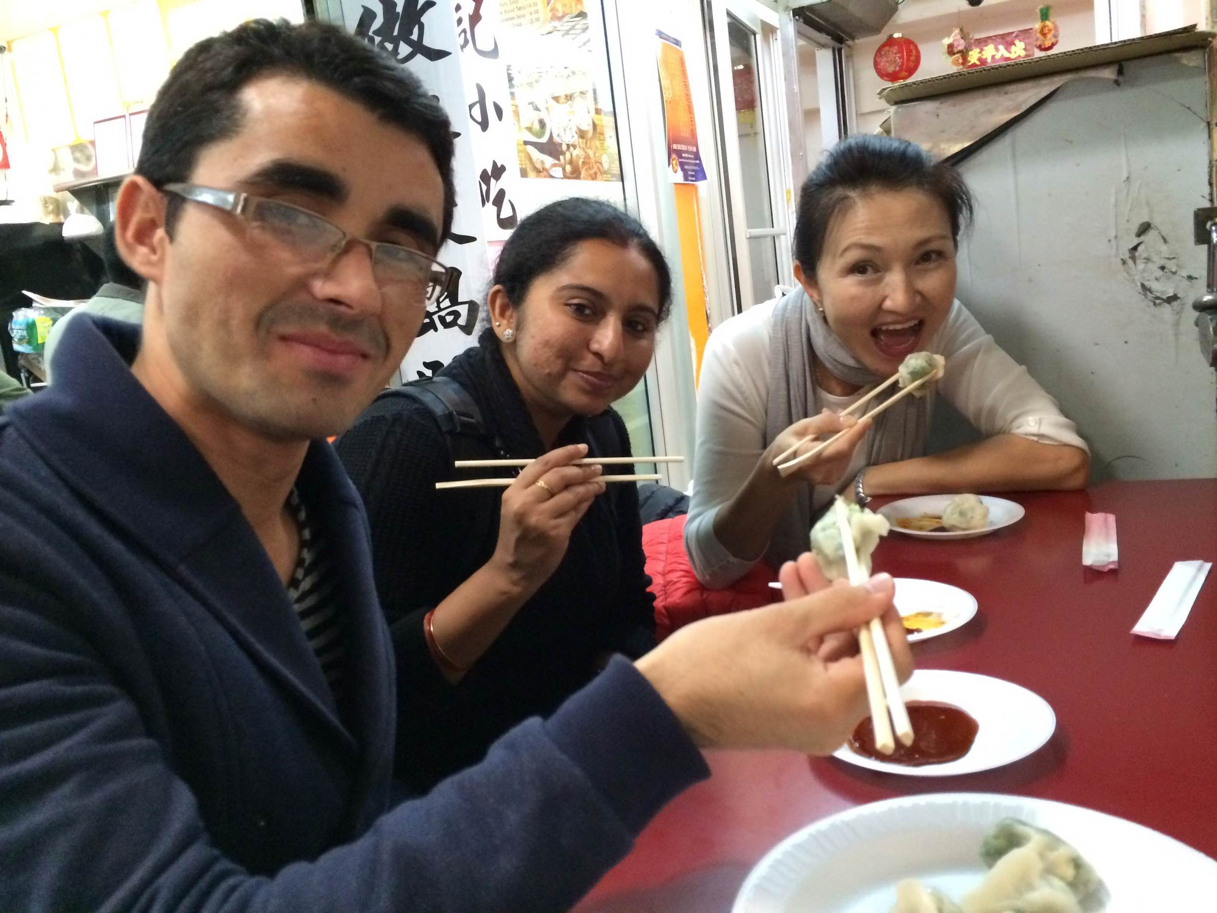 Eating dumplings in Flushing as part of the One-to-World Discover New York day. Left to right: Sayeed (Afghanistan), Nidhitha (India), Farida (Kyrgyzstan) at Golden Mall in Flushing.