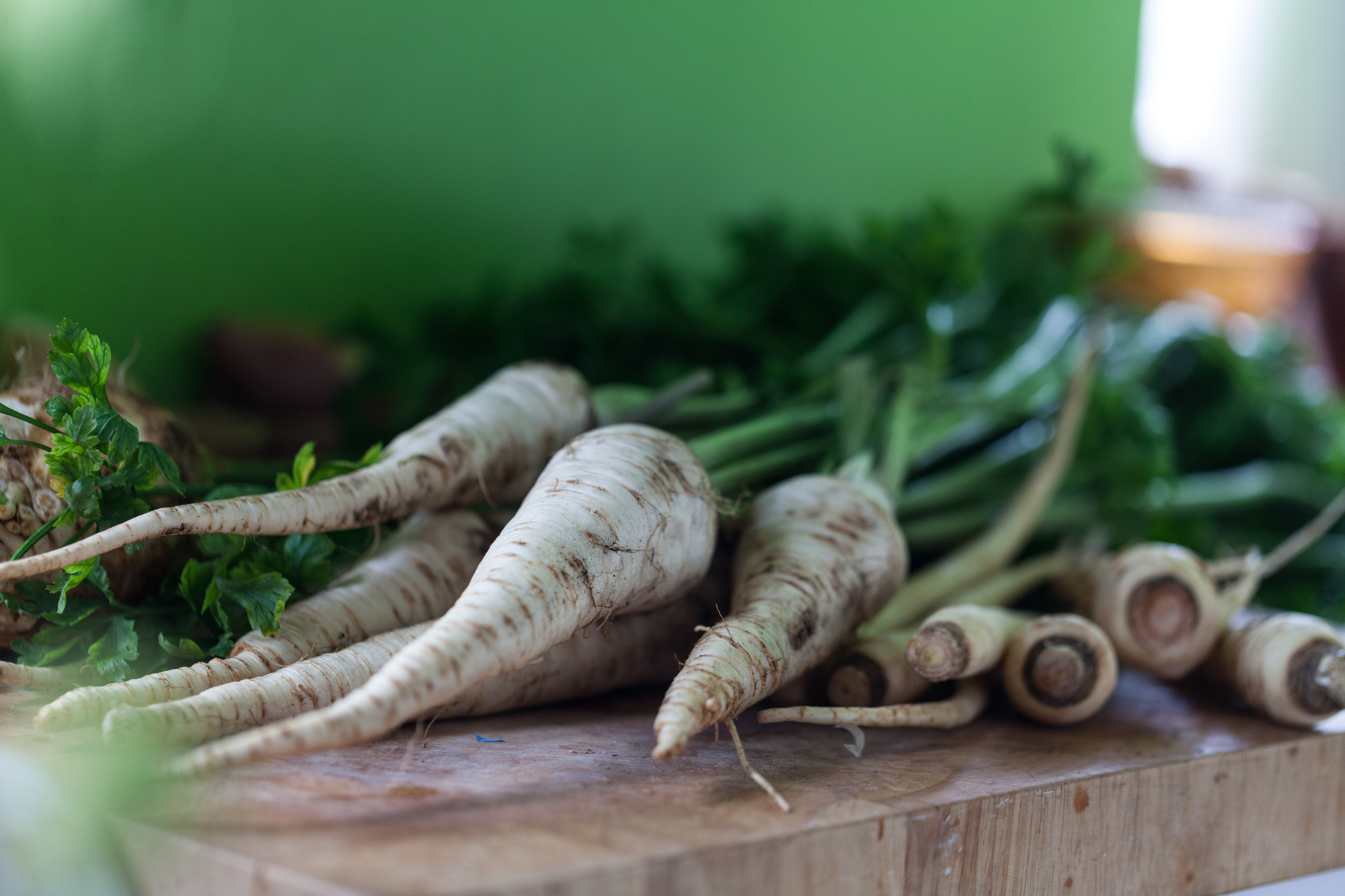 It's a little challenging to tell parsnips and parsley roots apart, unless they come with their tops on. Seen here in this frame from far left to right: Celeriac, parsley roots, and parsnips.