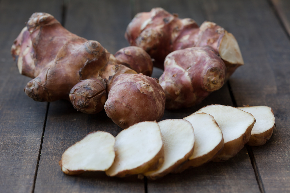 Sunchokes are the tubers of a plant in the sunflower family. They have been gaining popularity among restaurants, so you can often find them now in farmers markets around urban centers. Though they are gnarly on the outside, they peel relatively easily with a sharp knife and cut smoothly.