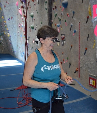 Elyn belaying at the BRC with her innovative belay glasses with clip on design.