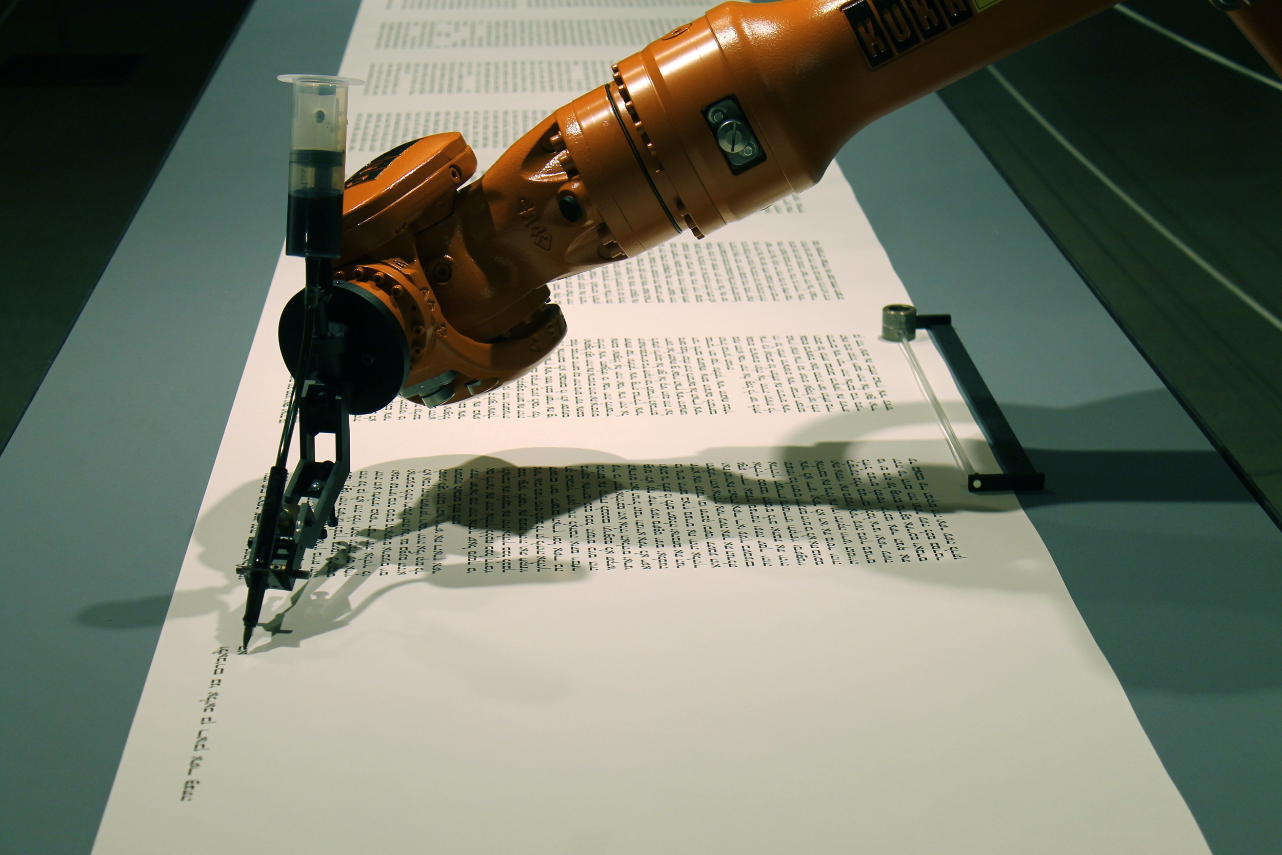 """This installation examinedthe industrial reproducibility of the torah as well asthe relationship between man and machine. Titled """"bios [torah]"""", it illustrated how the bios system (that all computers are built upon) is as""""fundamental to the development of the machine as the Scriptures are the cultural history of mankind""""."""