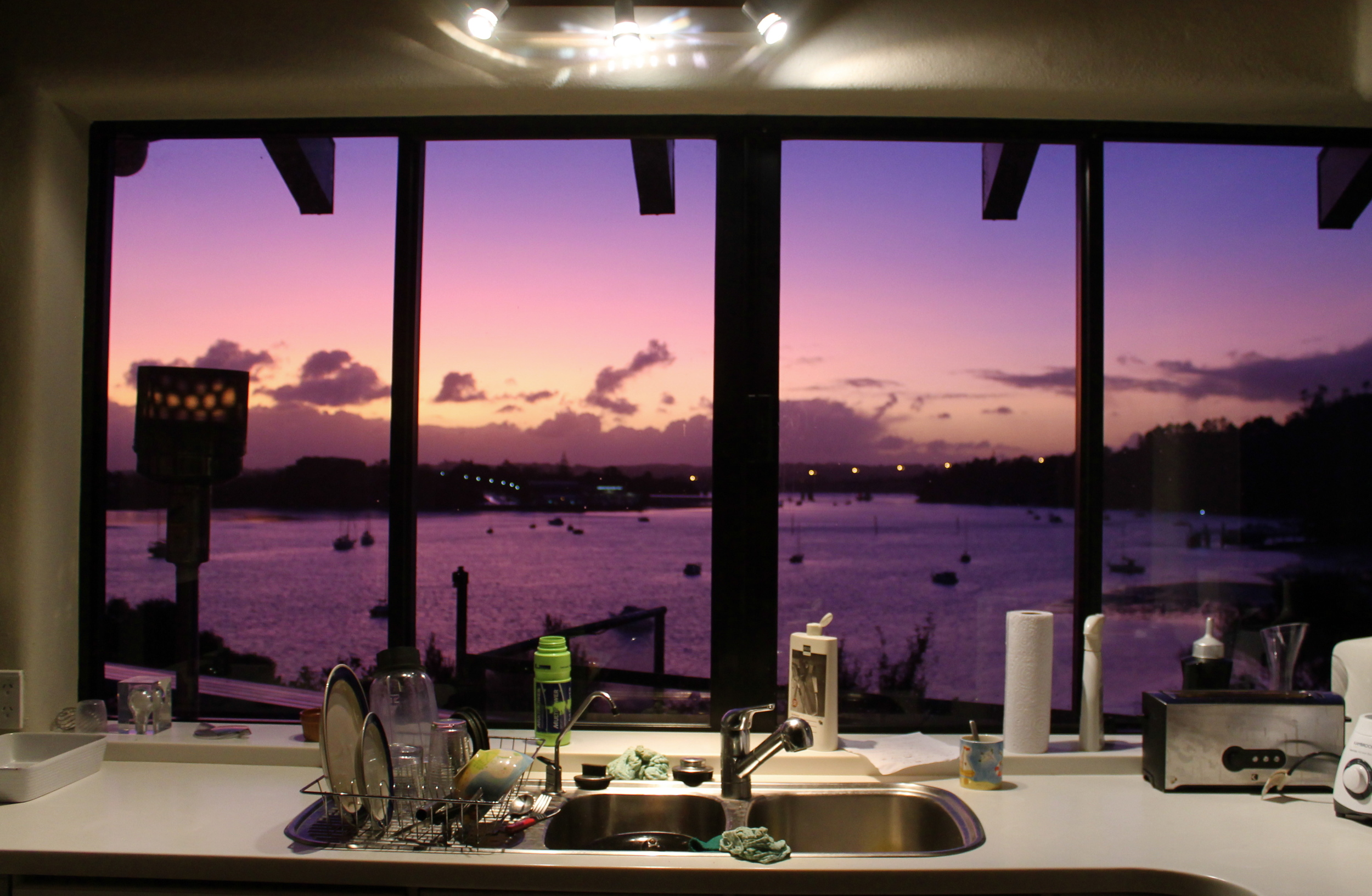 Violet sunsets make for a nice view while washing the dishes.