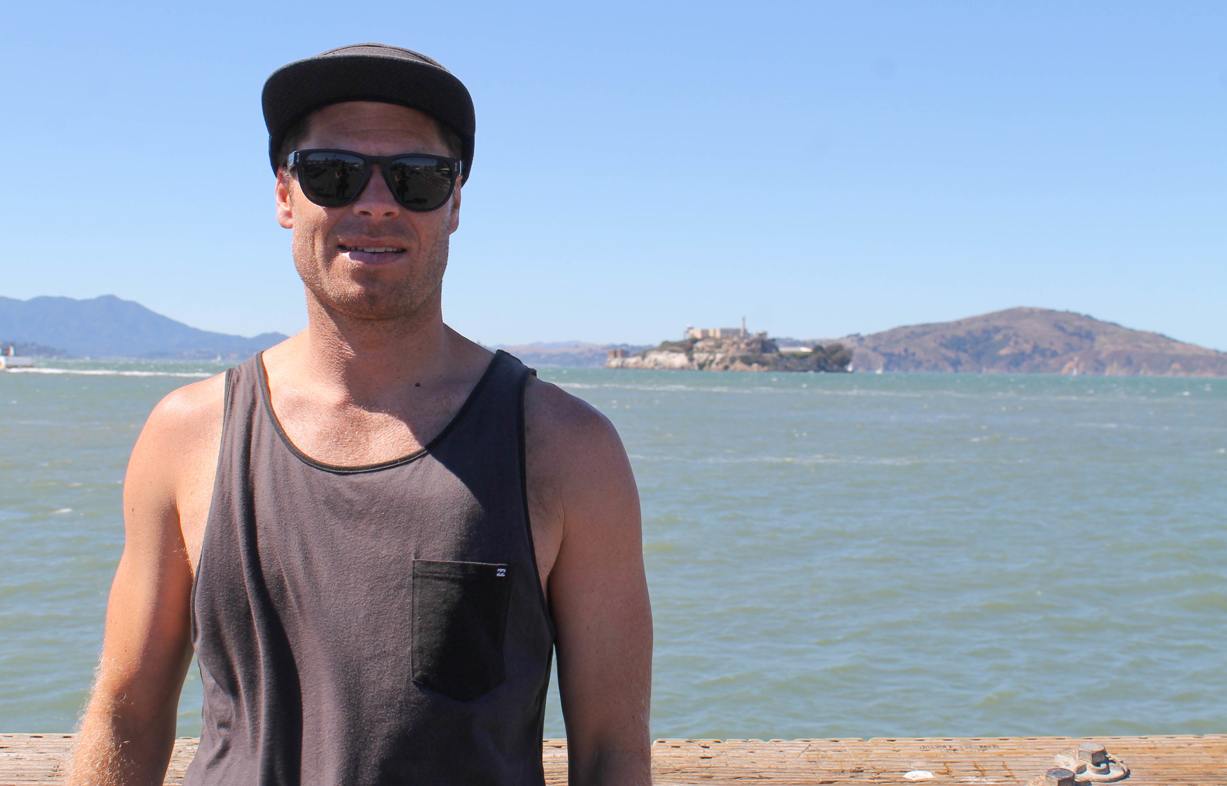 In front of a blurry Alcatraz.