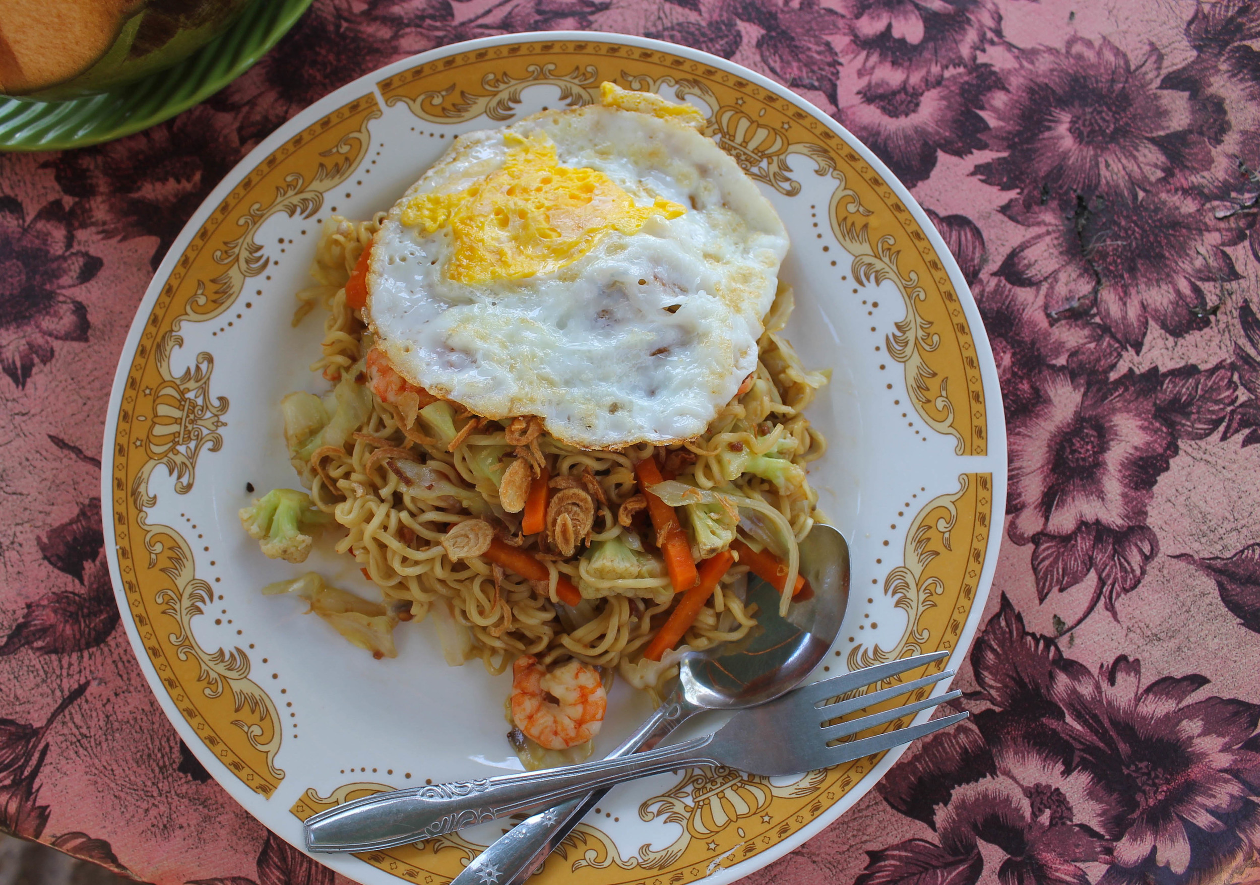 I got this Mie Goreng at a beach shack (like actual shack, not just a fun attempt at quirky decor) and I was raving about it until I saw that it was actually just made from a 2 minute noodle pack (to be fair,they did have a limited kitchen in said shack) and then began to question why the 2 minute noodle dishes I often made during college were garbage compared to this one that again, was made in shack.