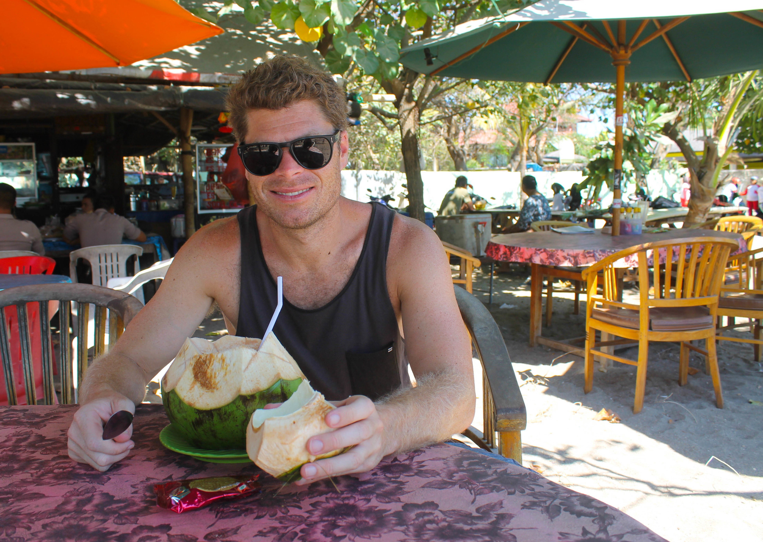 Here is Scott with freshly cut coconut water that cost approximately 10 cents (!).Makes you question all those times you bought $8 coconut waters after a hot yoga class because you thought you really needed those electrolytes.