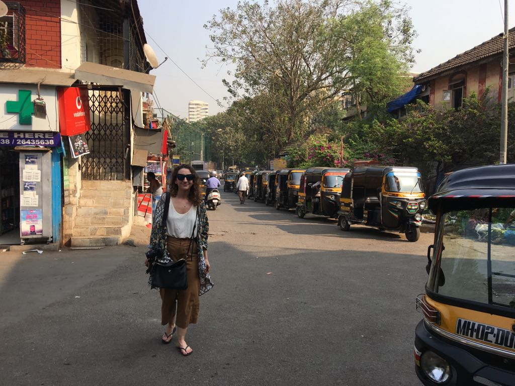 Among the tuk-tuks/rickshaws.