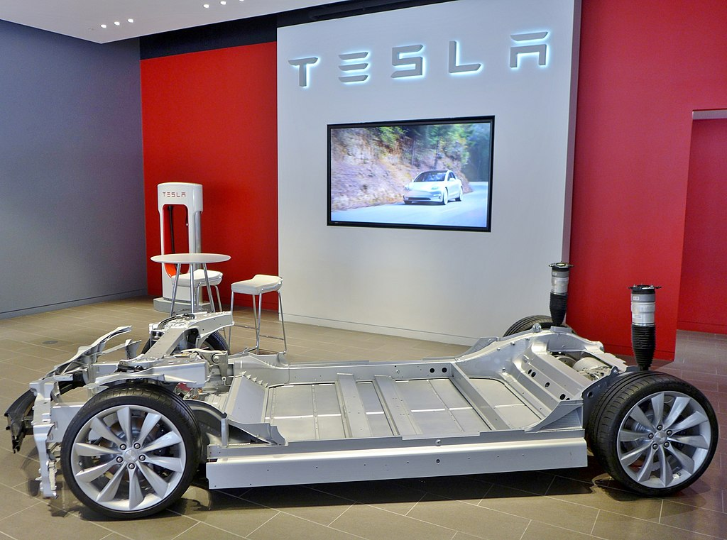 The 'skateboard' chassis used by Tesla allows them to support large battery packs and their cooling systems. Reducing the space needed for cooling is one way weight efficiency has improved in recent years.