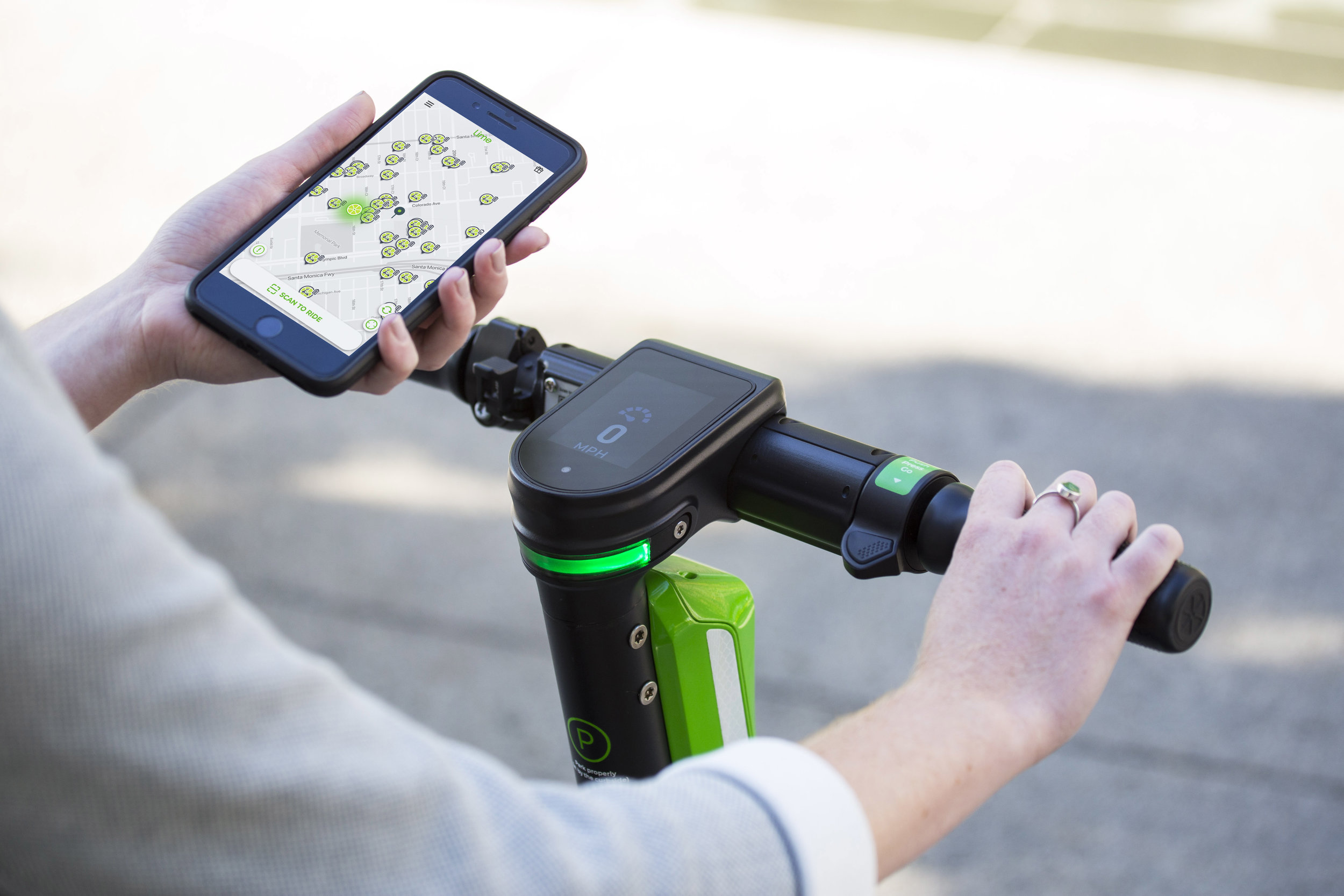 The Lime scooter handlebars and app