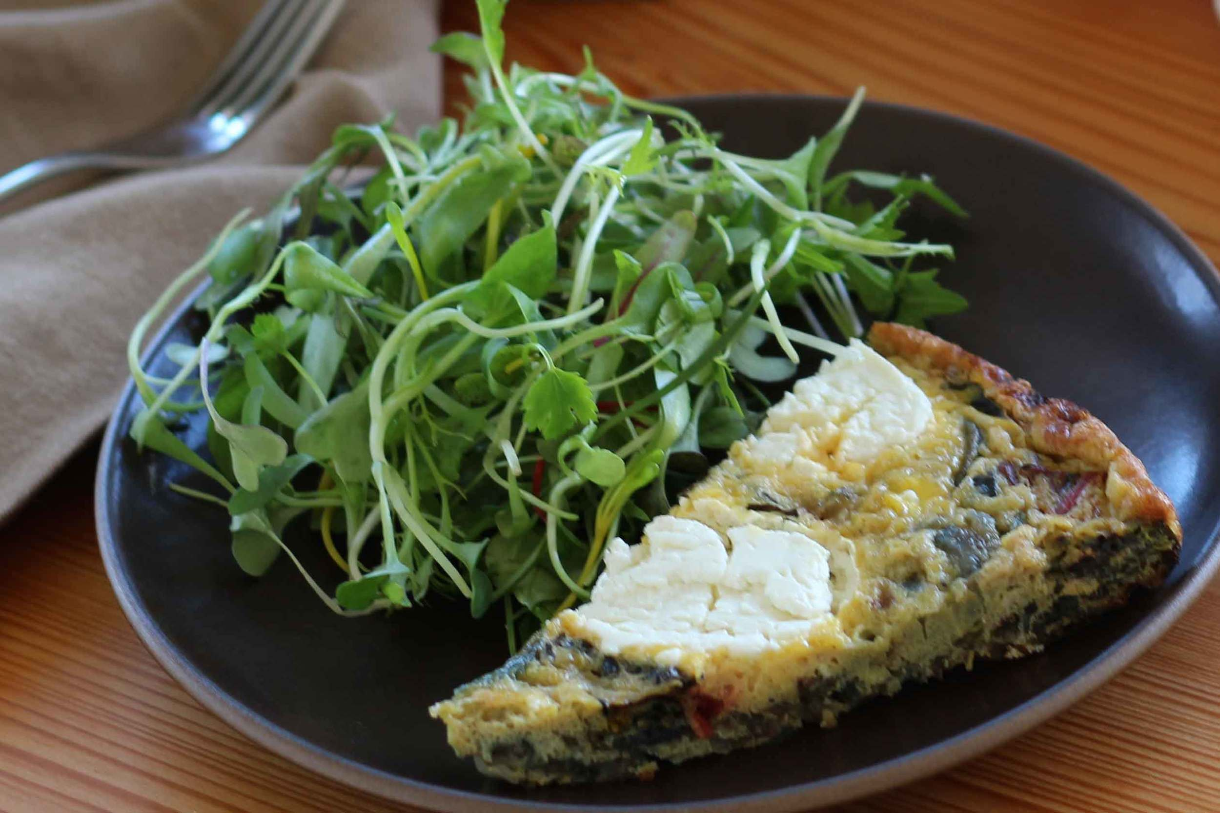 A salad of fresh herbs and tender greens makes a nice accompaniment for a wedge of frittata.
