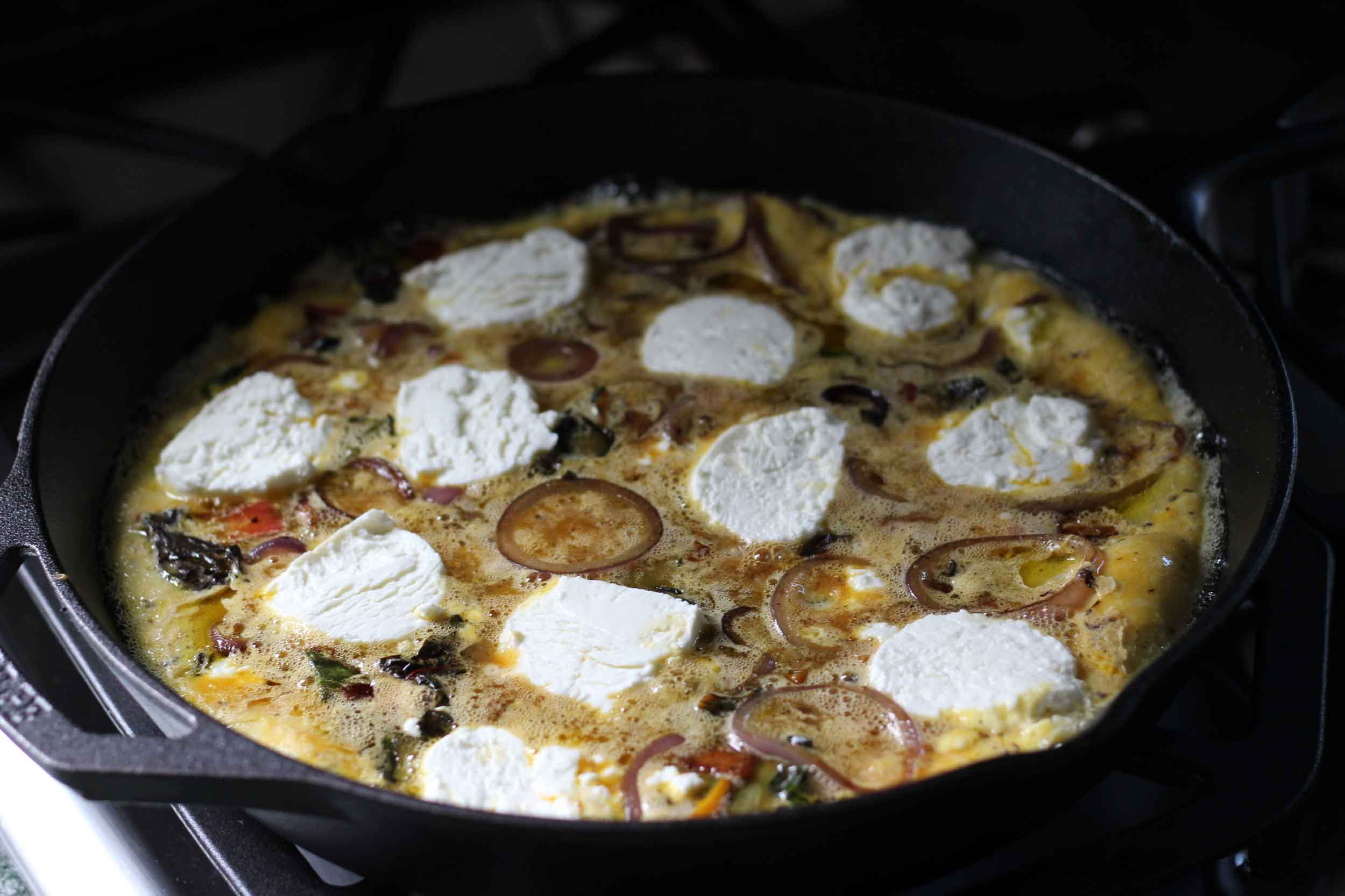 bubbling frittata on stovetop