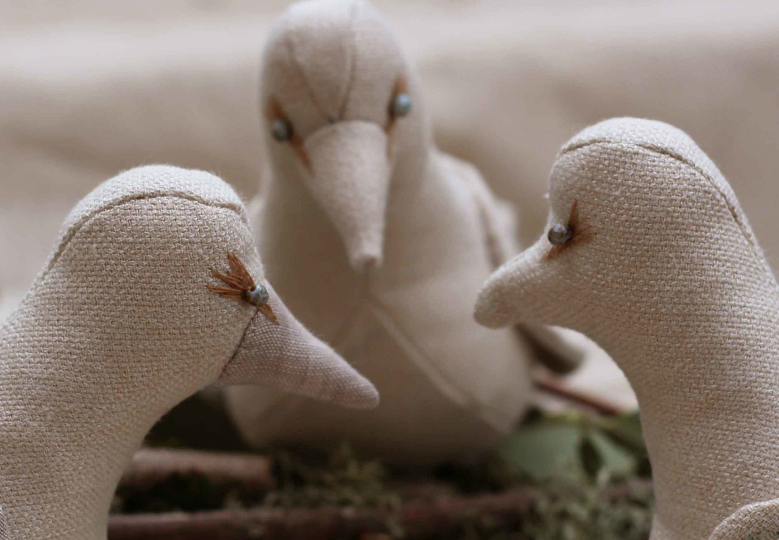 Doves on the left with separate beaks, dove on the right with built-in beak.