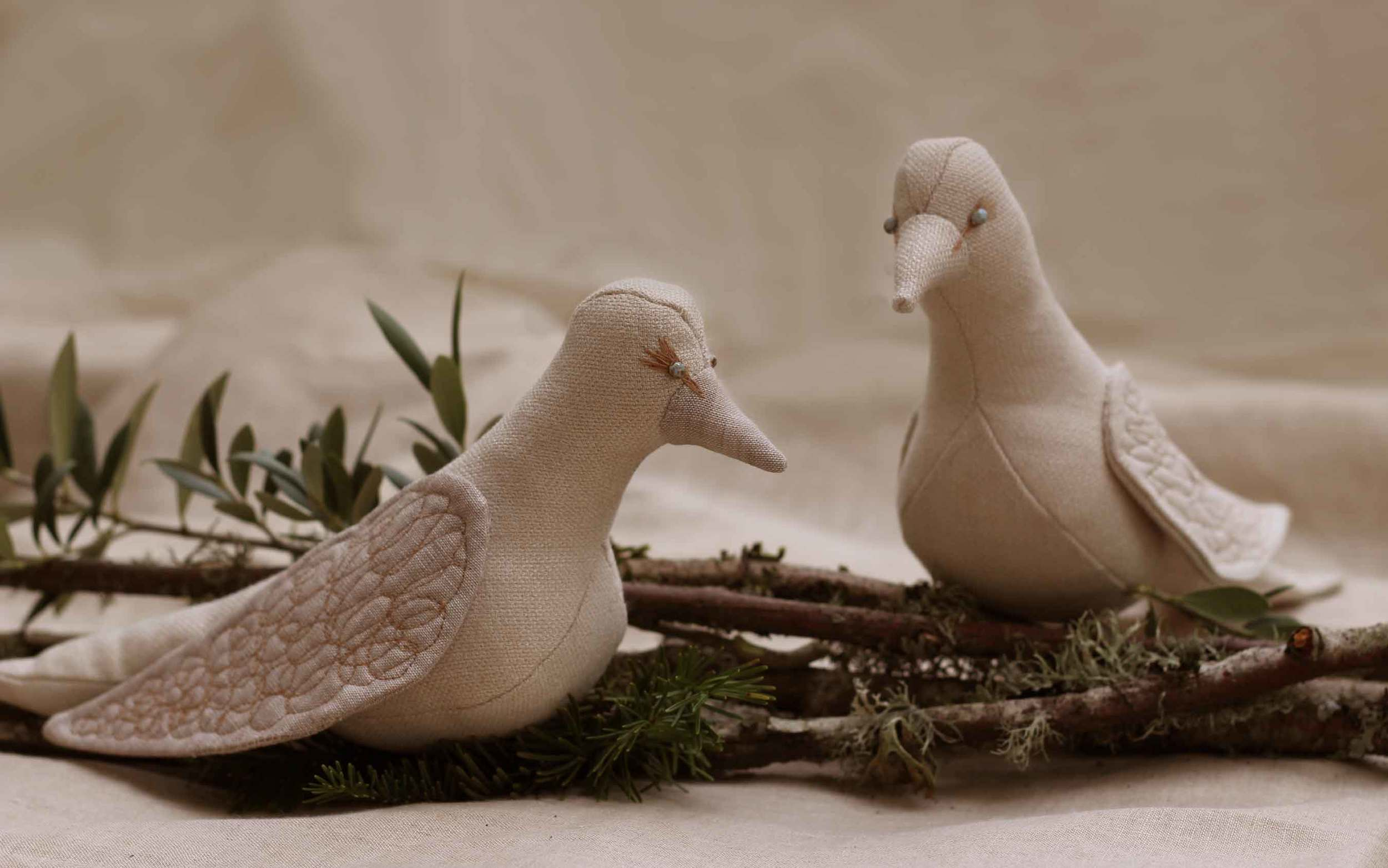 2 handsewn linen doves on a branch, bird softies, design by Thread & Whisk