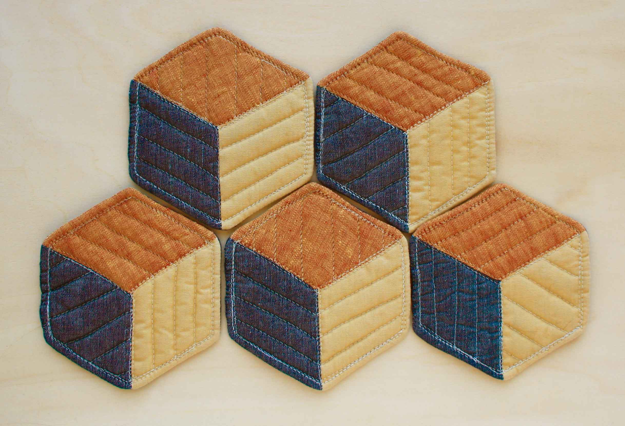 Fun with color and shape.  Quilted coaster instructions at Thread & Whisk.