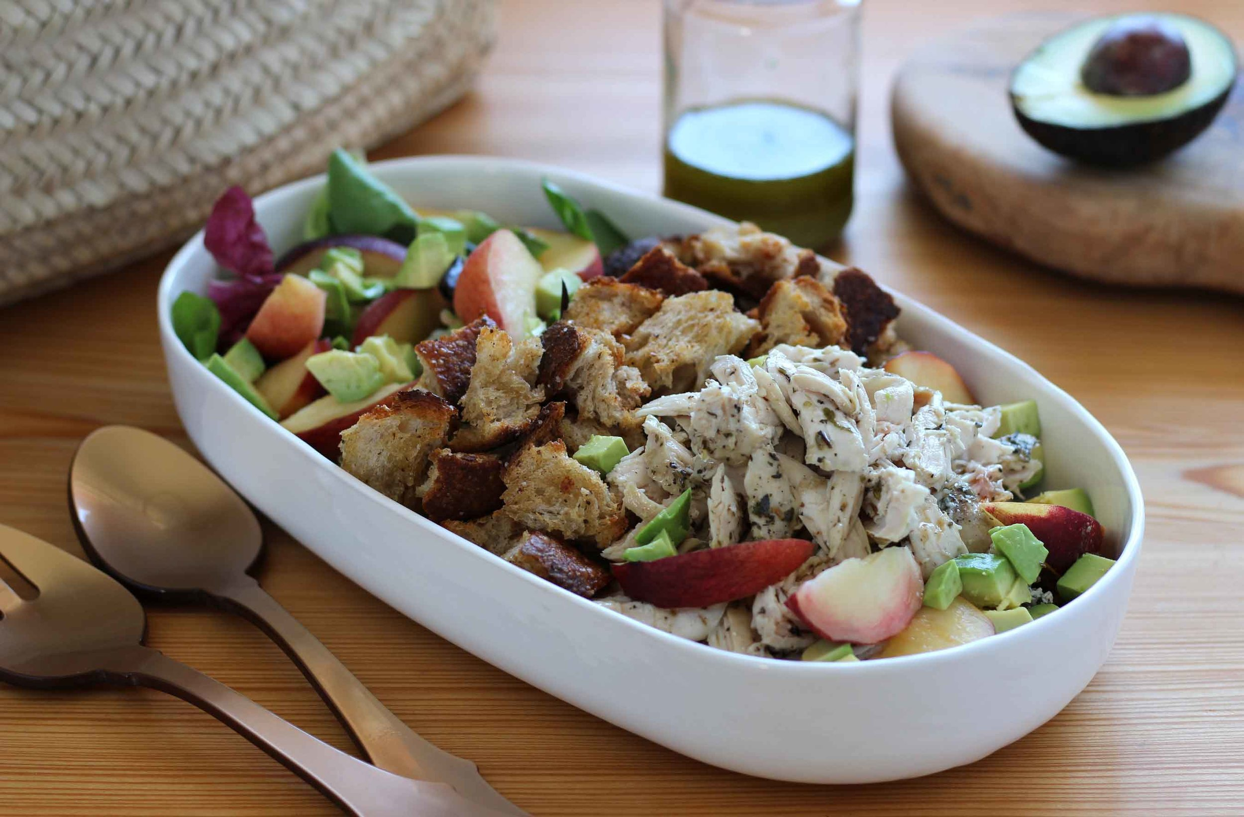 Shredded chicken is tossed with Herbs de Provence, our peaches and avocados sliced, our hand torn croutons are crunchy, and the freshly made basil lime vinaigrette is waiting to be tossed in. Can't wait!