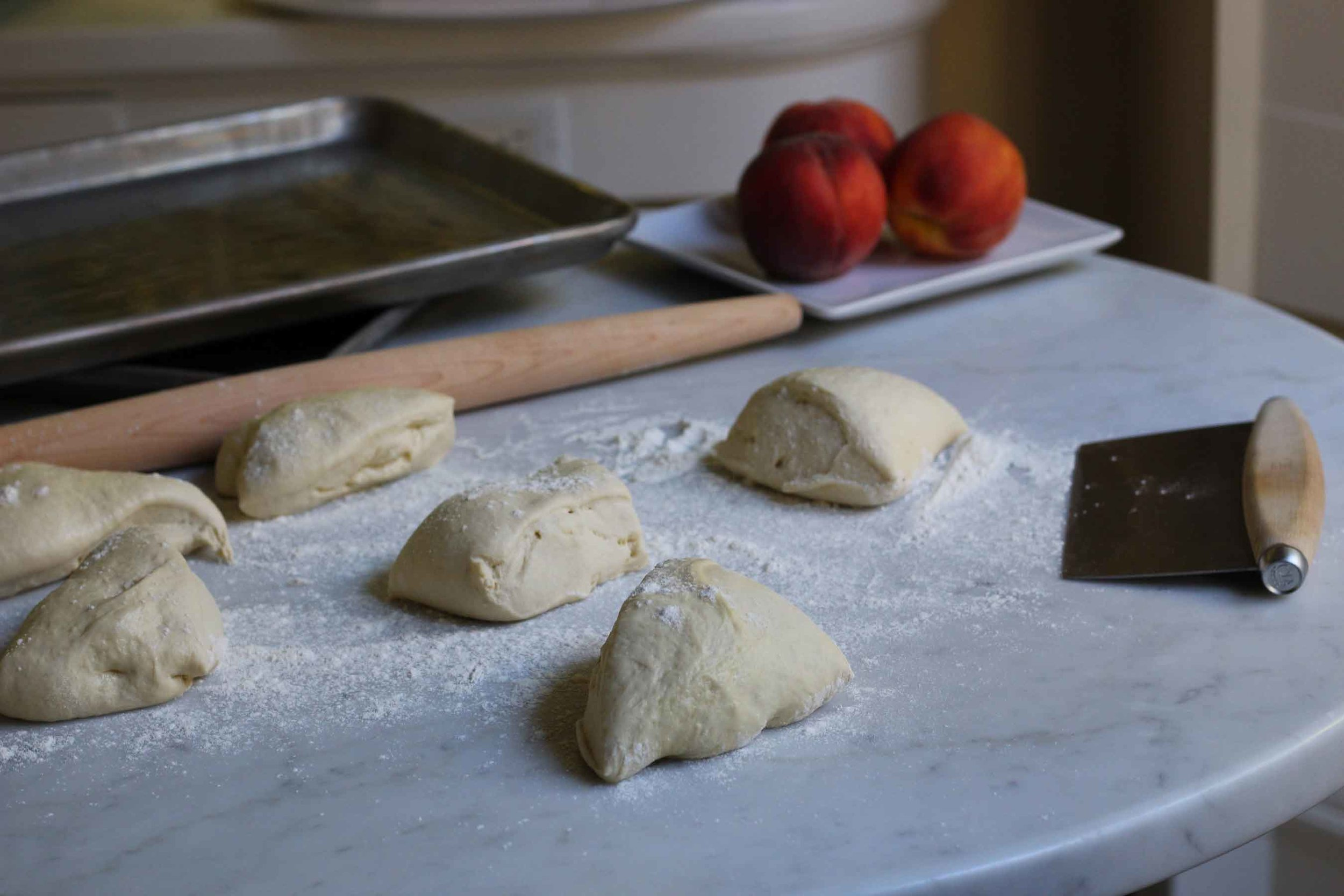 Cutting homemade pizza dough