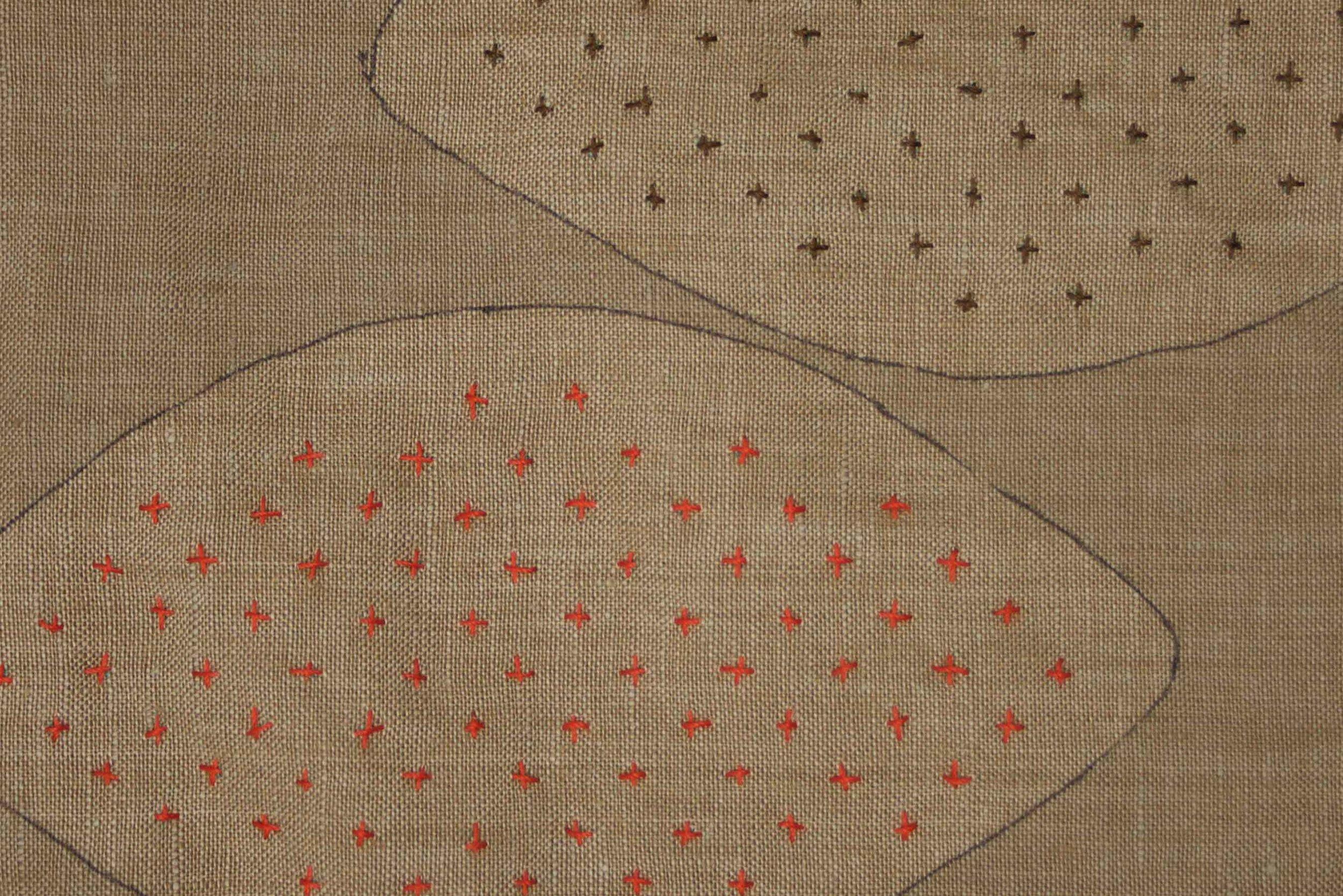 Sashiko style hand-stitching in colorful thread