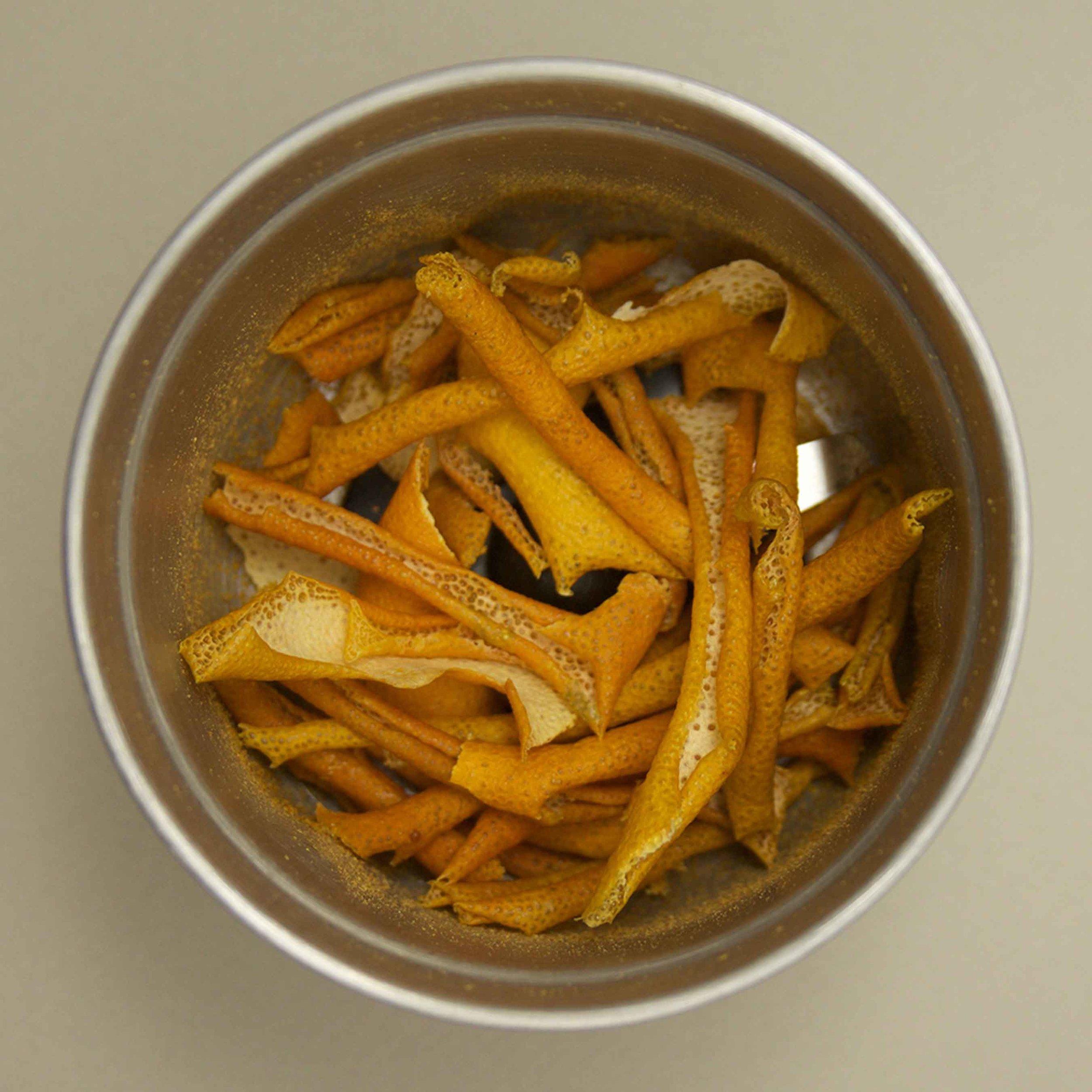 Dried orange peels, wait to be ground
