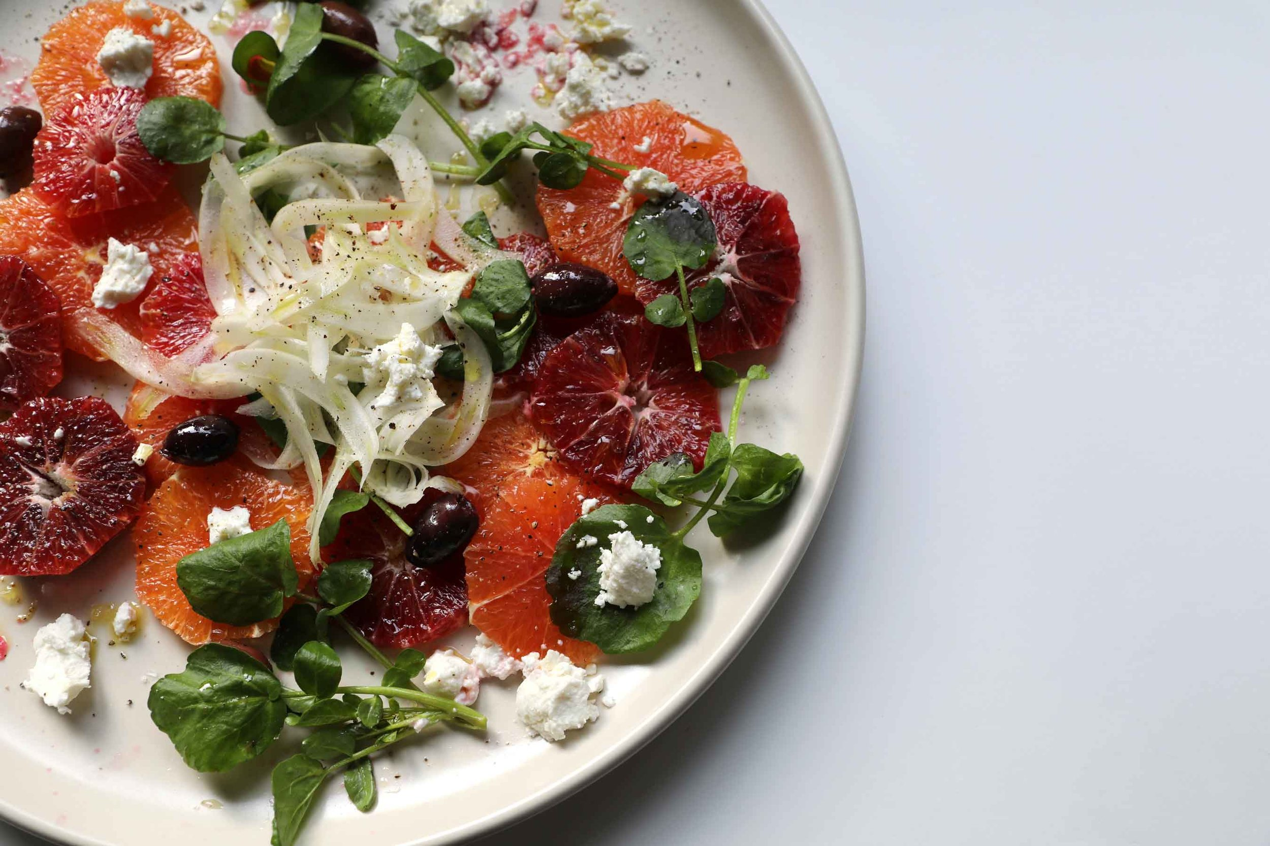 In the midst of winter, a vibrant citrus salad with fennel, kalamata olives, watercress, and goat cheese is a beautiful day brightener. Add this simple and elegant salad to your menu this week using Cara Cara and blood oranges, Ruby Red grapefruit, or whatever juicy citrus you can find at your market.