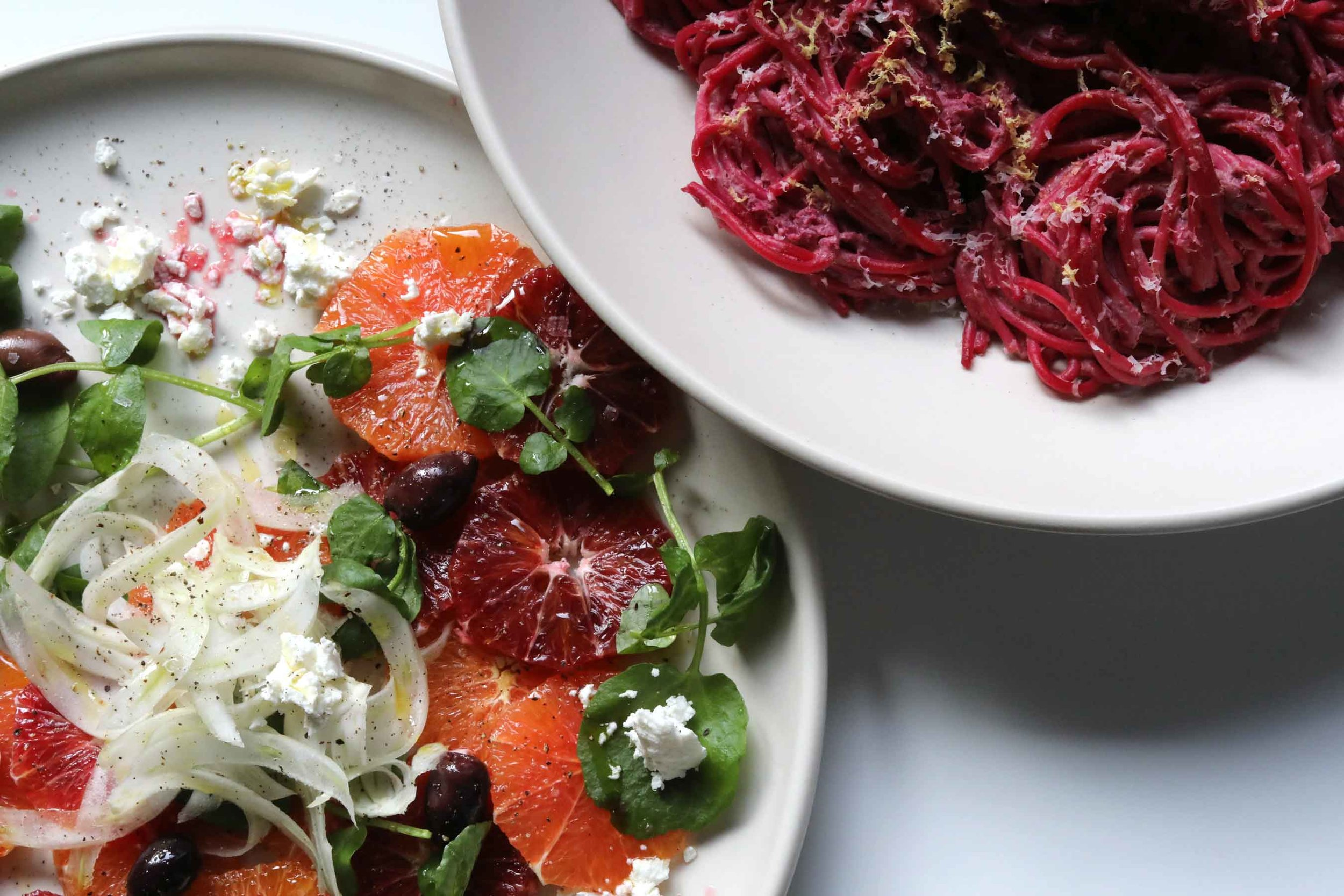 Thread & Whisk's Orange, Fennel, and Watercress salad served alongside The Impatient Foodie's Beet Ricotta Spaghetti . Vibrant color + Complementary flavors & textures = a delicious winter meal. A simple-to-make meal that looks and tastes restaurant quality.