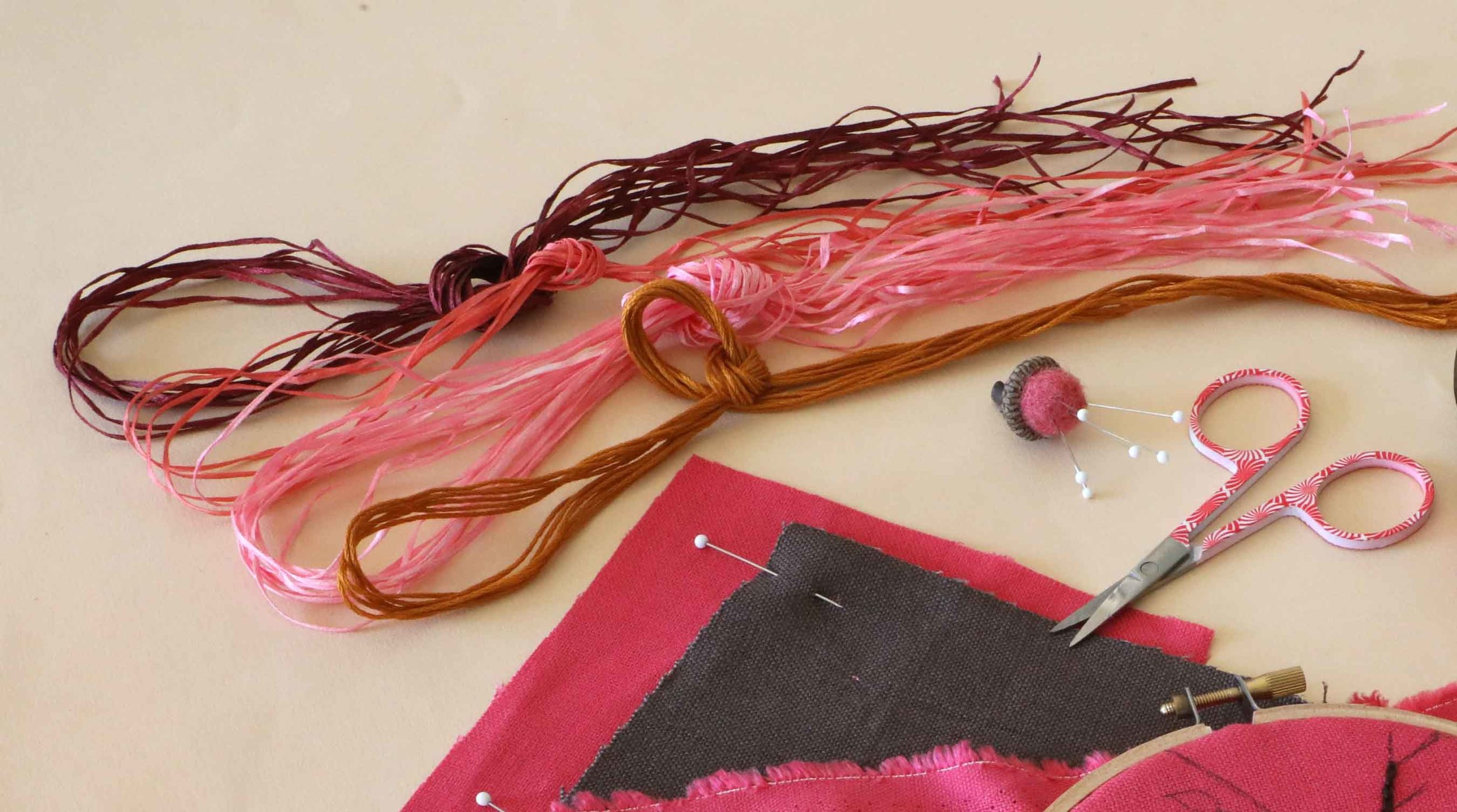 With a bright pink linen to stitch on, we chose a more sedate, vintage feel for the embroidery floss and straw silk colors. Our plum blossom design celebrates Spring renewal, in the spirit of Hanami.