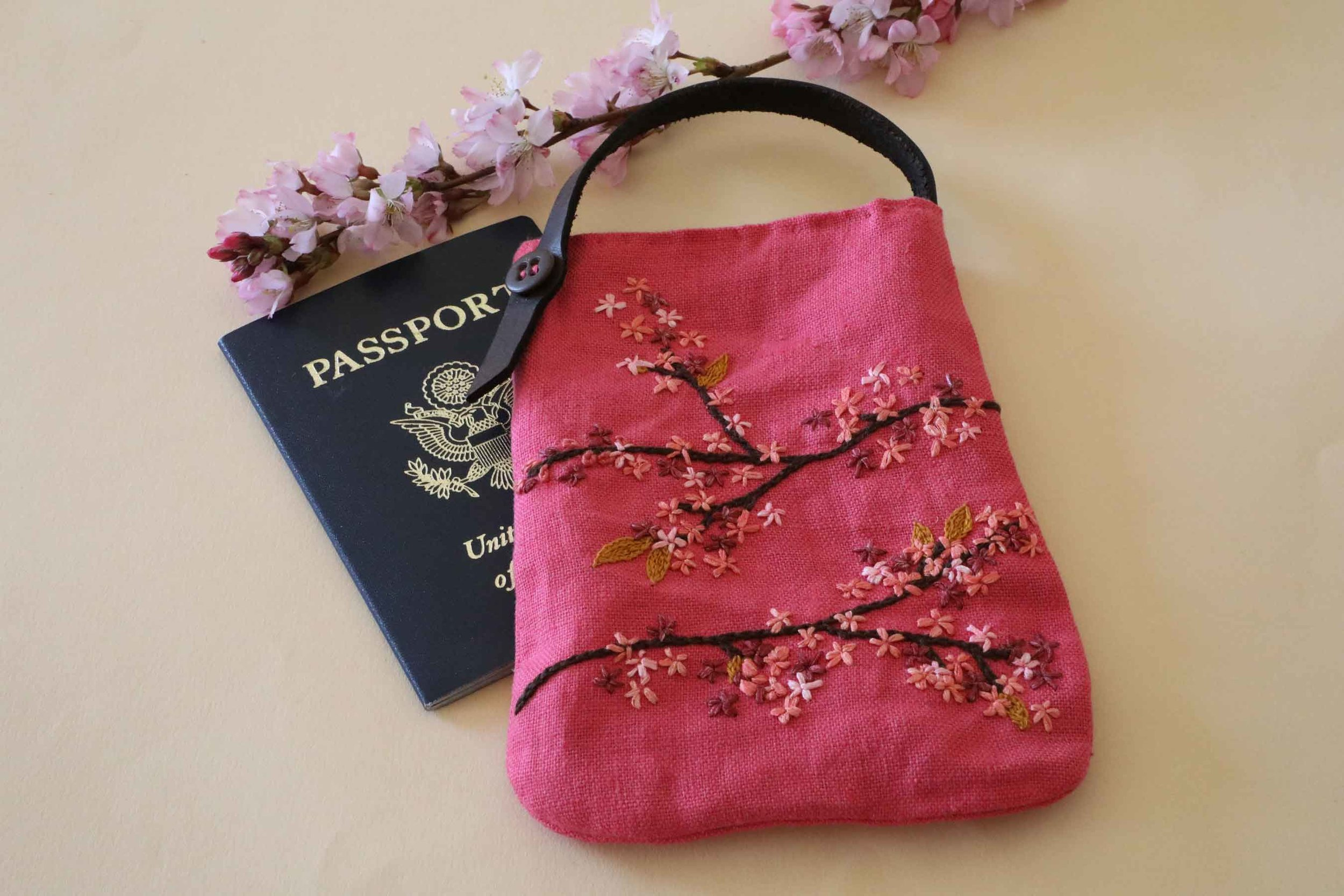 We are headed off to Japan in our dreams and we are taking this little hand-embroidered linen bag. It is the perfect size for our passport and a lipstick. Pink, of course.