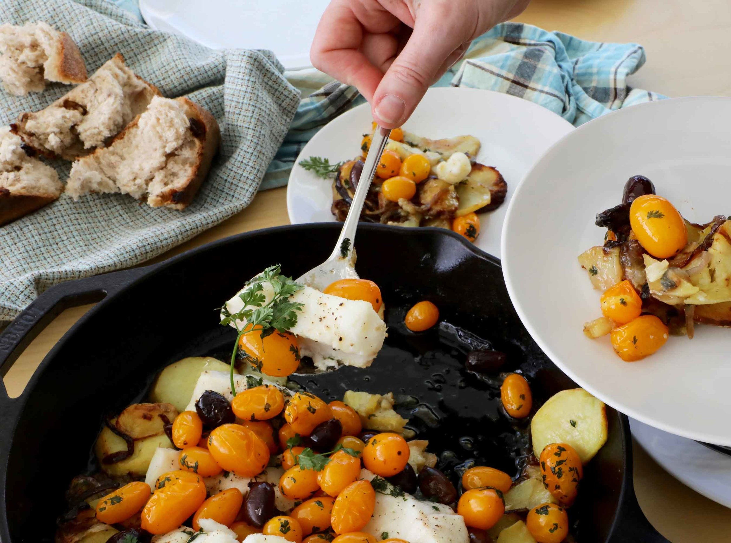Serving up some fish, caramelized potatoes, olives and tomatoes straight from the skillet at the table. With some crusty bread to sop up the juices, this is a simple and delicious one pot meal.