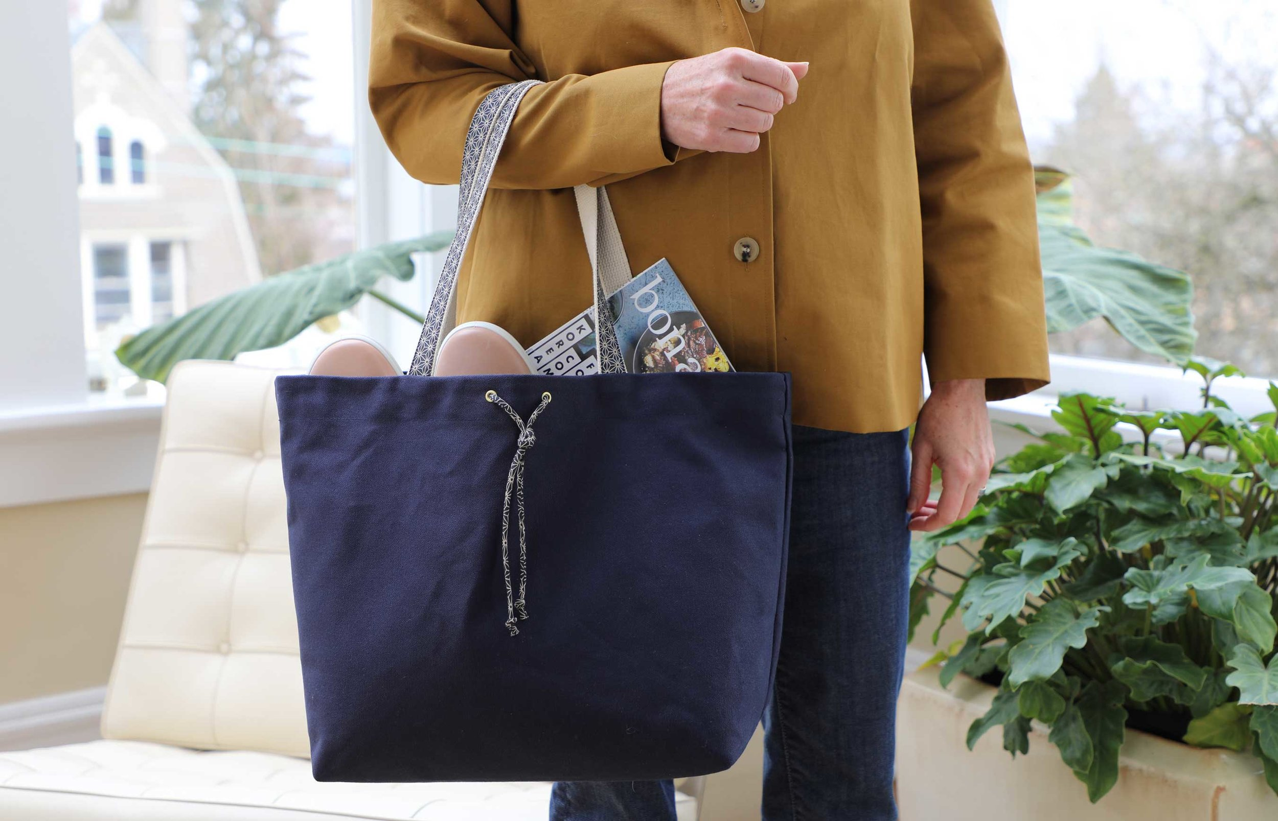 Carry all your goodies in style with the Calla Tote. This simple tote combines fashion and function: Fit your laptop, your workout clothes, and your lunch in here, leaving your purse to take care of her own duties.