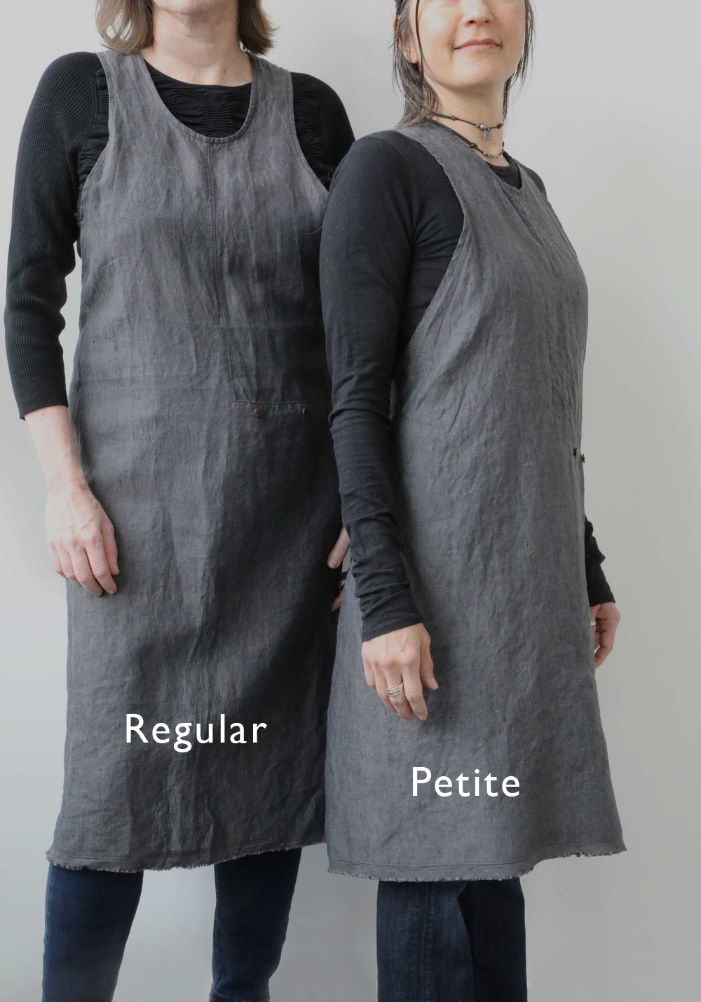 "(The model on the left is 5'6"" tall. She is wearing our Regular apron. The model on the right is 5'2"". She is wearing our Petite apron)"