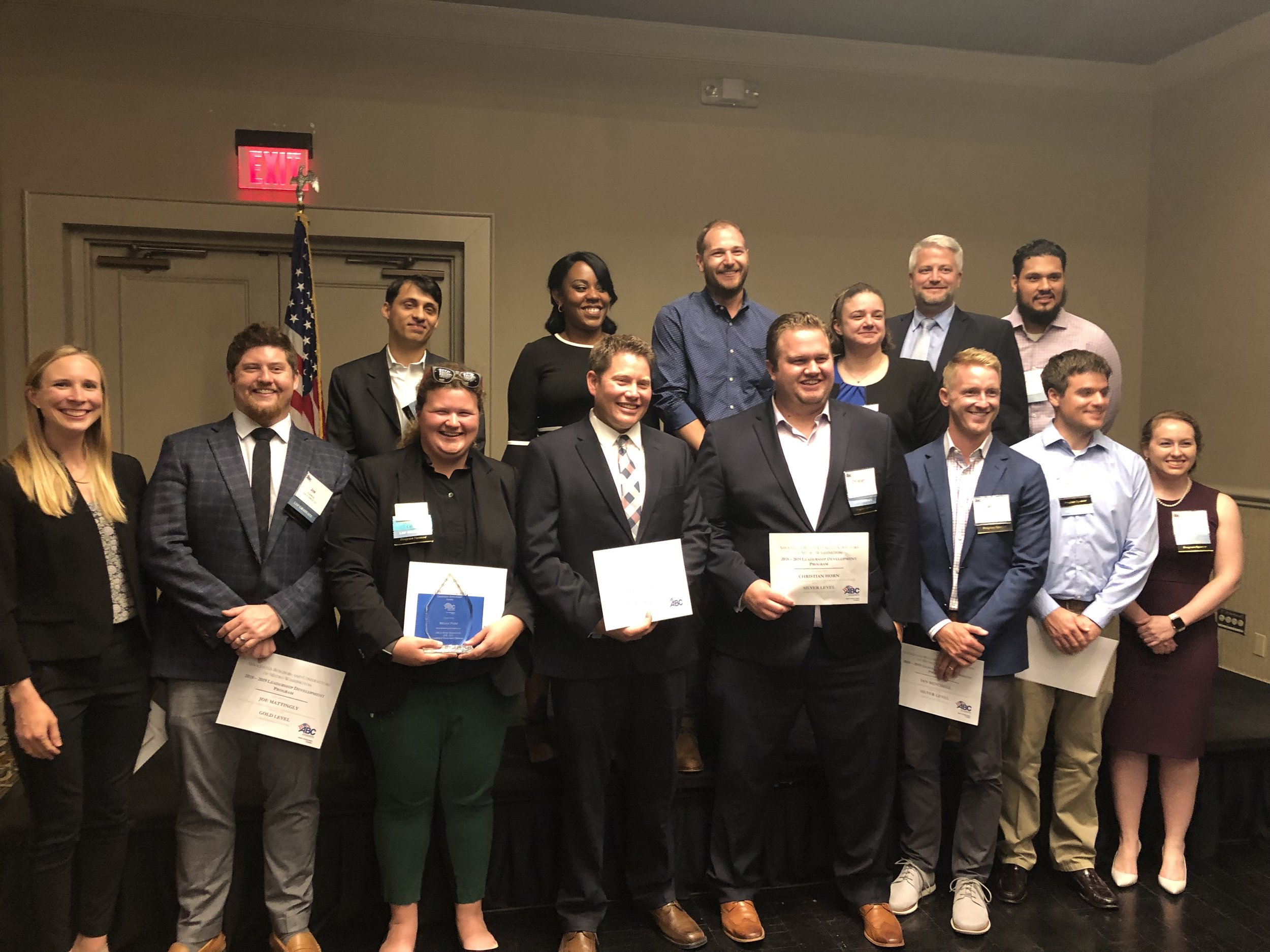 The 2019 ABC Leadership Development Program graduates show their certifications.