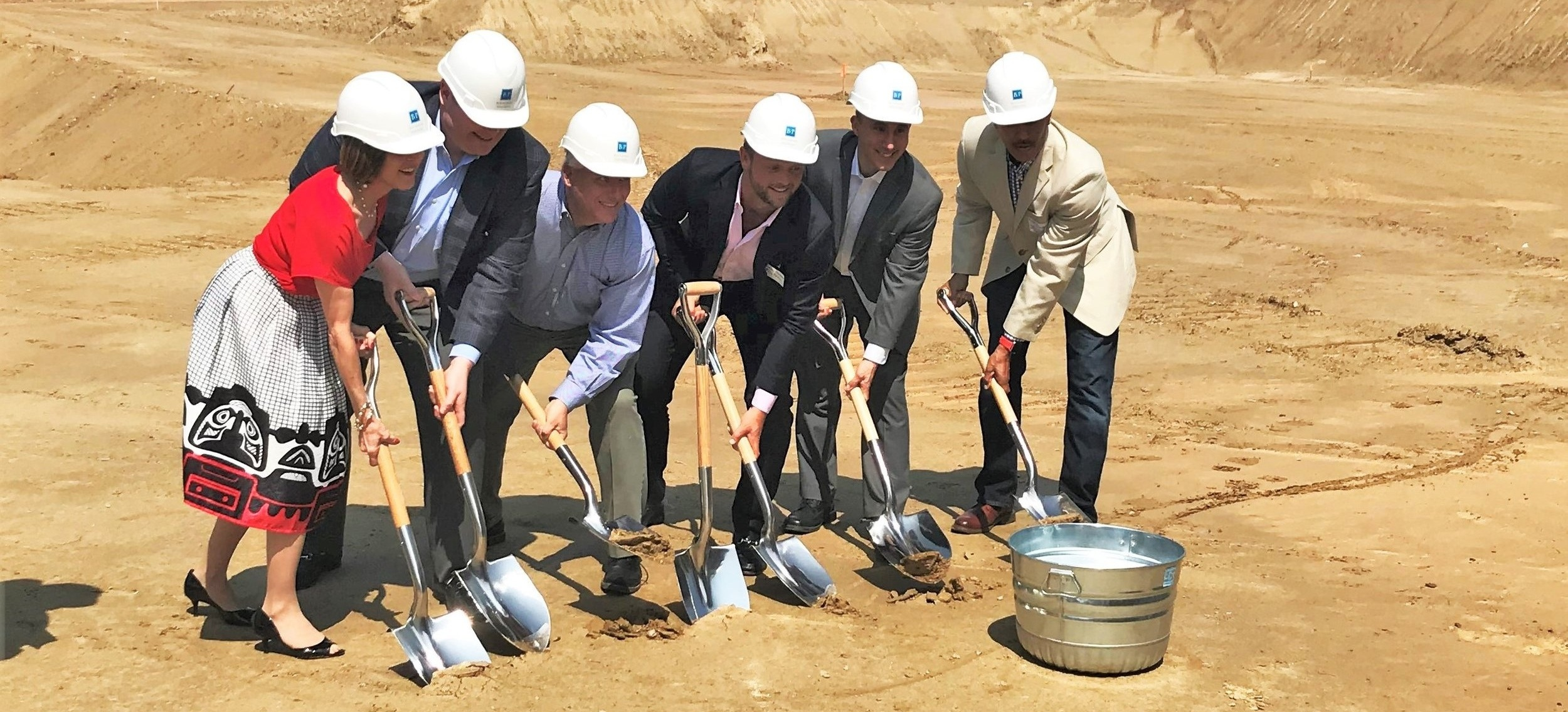 Buchanan Partners dug their shovels into the dirt at the Atelier Apartments project site in Silver Spring, Maryland