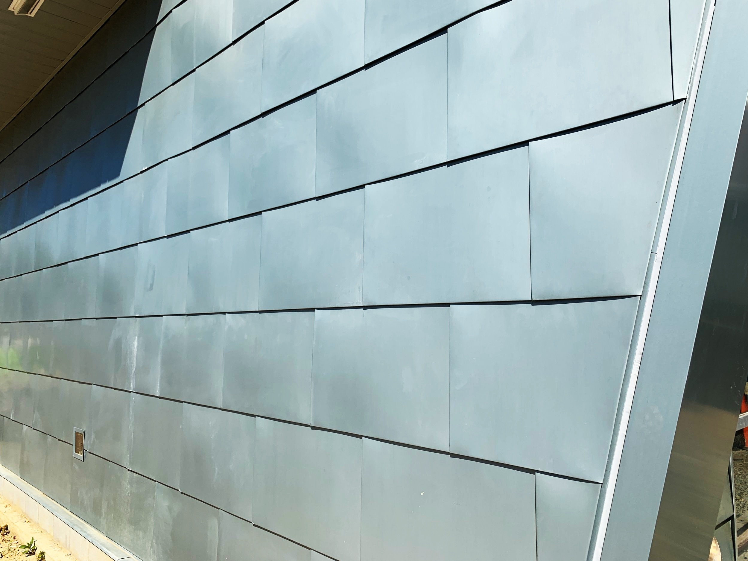 The exterior has been covered in zinc metal panels, imported all the way from Germany.