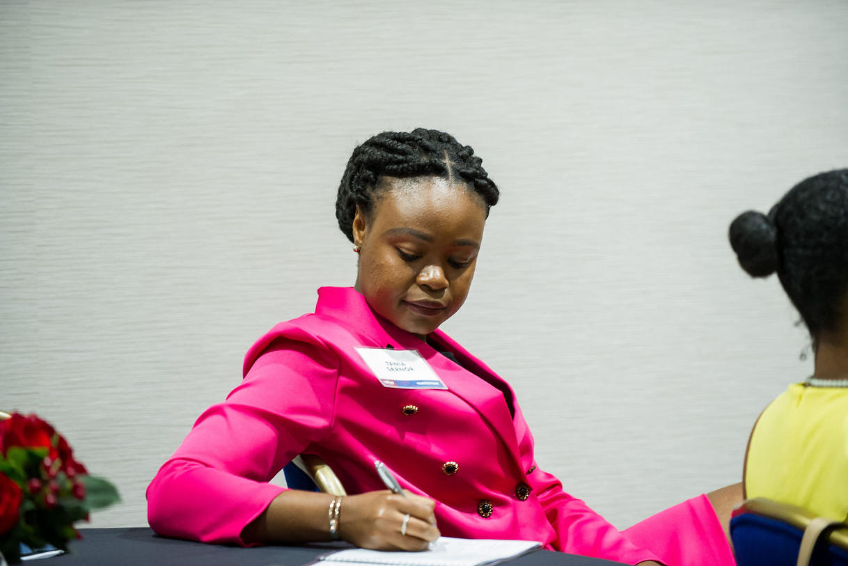 The attendees took notes as Barbara Price gave advice to women in the workforce. (Photo Credit: Kea Dupree)