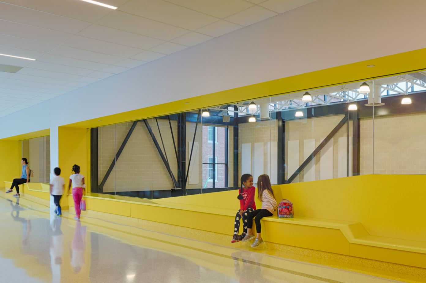 In an Instagram post by one of Bancroft's architects, Brian Gruetzmacher, he states that the bench overlooking the gym was designed to work for all ages from toddlers to adults.