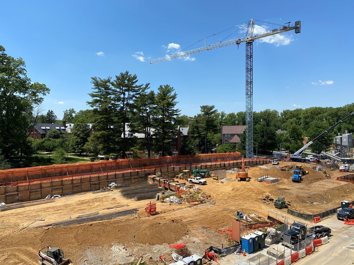 """This image spotlights the first of two tower cranes that will be erected on the #NIH UVPPG project by Miller & Long Concrete. The tower crane is 218'-0"""" tall with a hook reach of 219'-0"""". This crane is located at the NW corner of the project and the crane pad is a 4'6"""" thick mat supported by four auger pressure grout piles installed by Berkel & Company. #BuildSomething #Construction"""