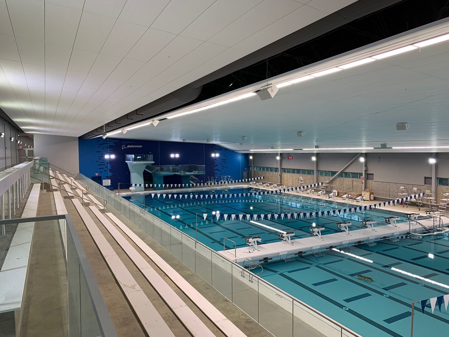 Check out the view from the spectator seating of the 50M Olympic sized swimming pool at the new Long Bridge Park Aquatics and Fitness Center in Arlington County. The pool is equipped with a gutter integrated air evacuator system which removes the chlorine & chemical smell from the surface of the water before it can permeate the natatorium. Also, the HVAC unit specializes in dehumidification to provide a crisp and pleasant experience for spectators. #Construction⠀ ⠀ 📸  Colin O'Donnell, Assistant Project Manager