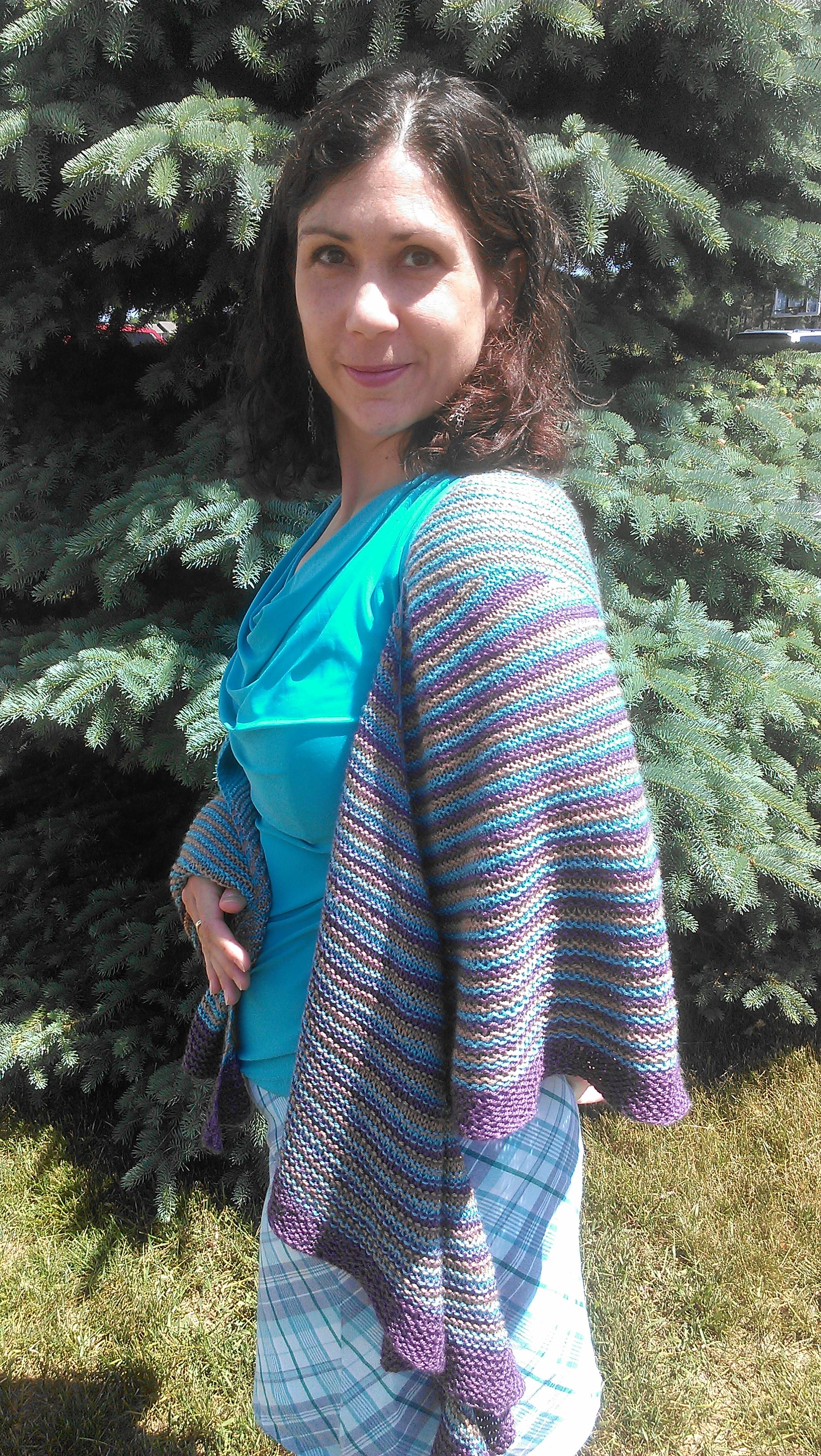 Jenn modeling a shawl she knit