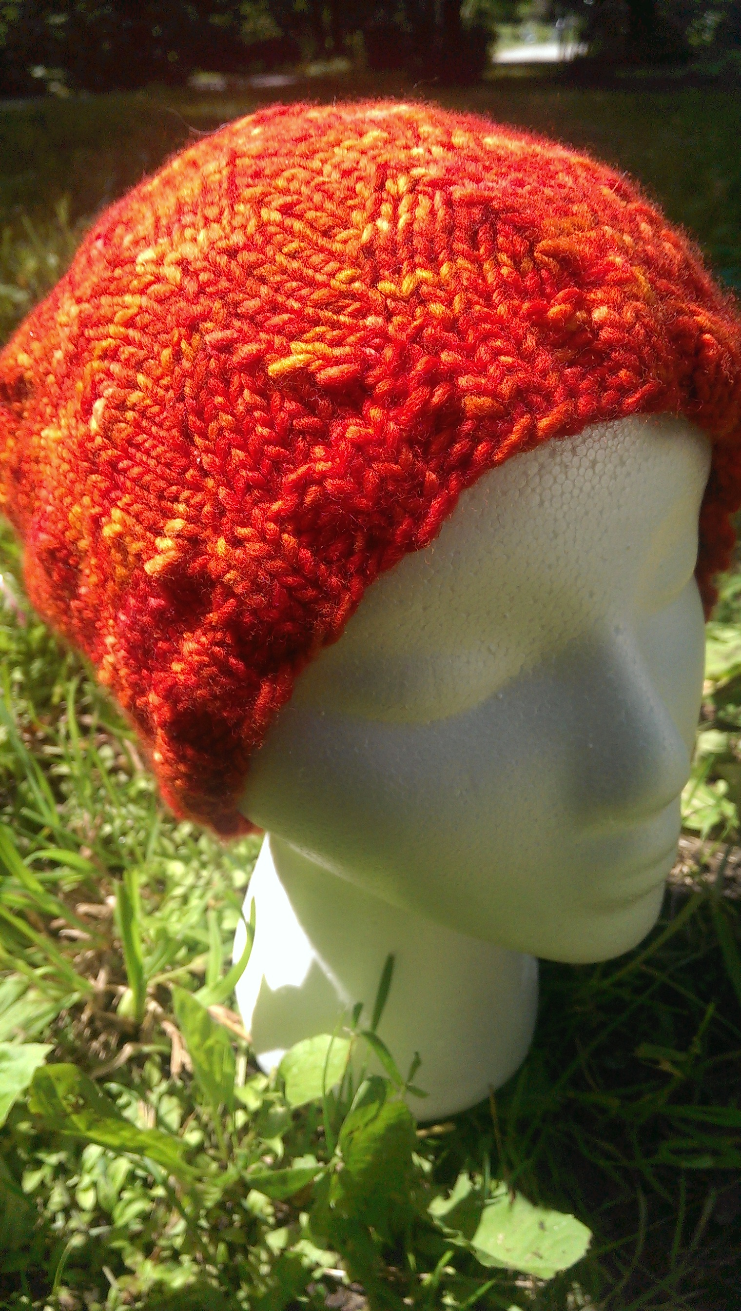 Fire Hat I designed using a stitch pattern from Barbara Walker's Treasury of Knitting Patterns, with Merino hand-dyed from Manos del Uruguay