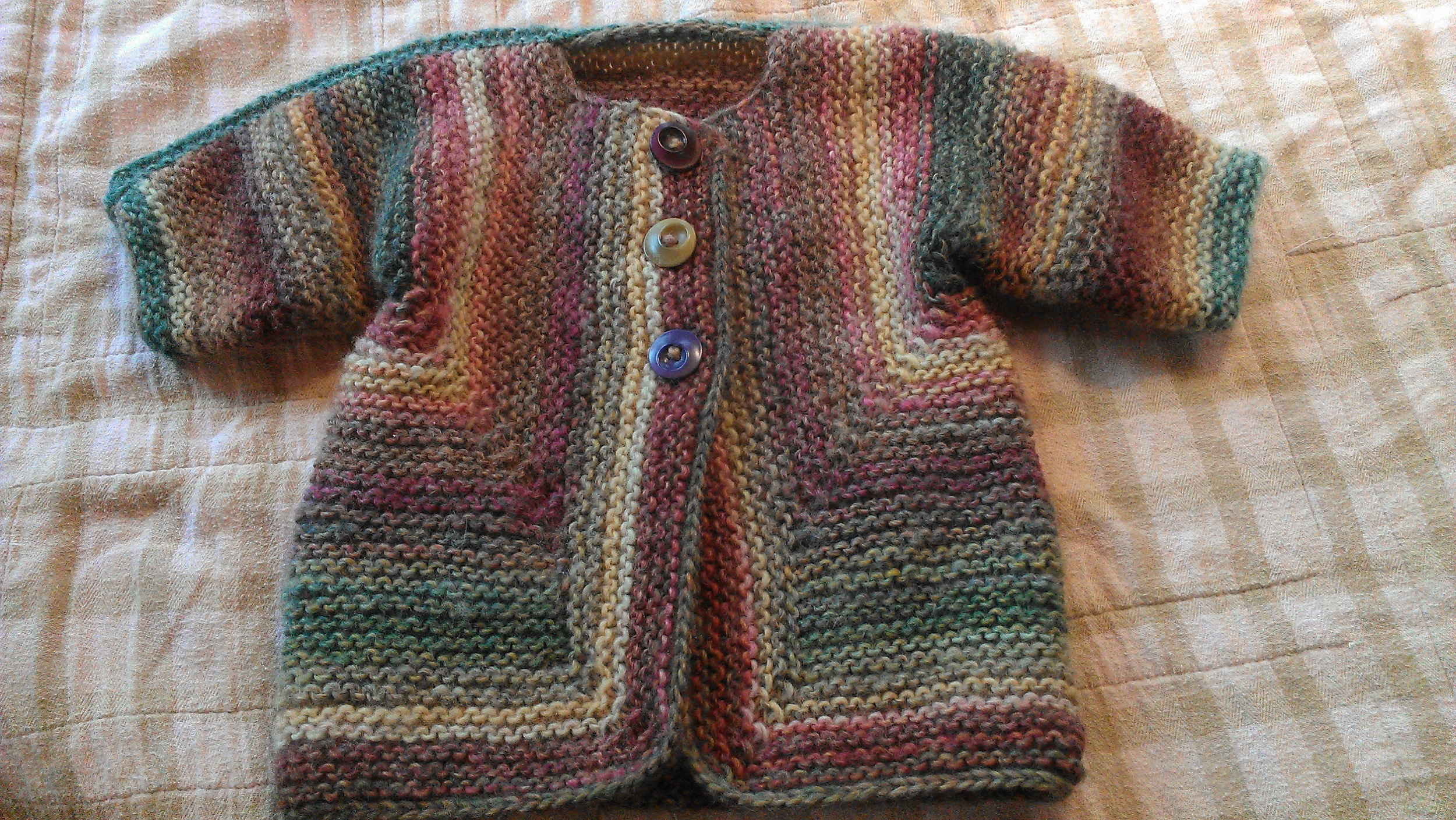 Baby Surprise Jacket, a very fun pattern. Knitting this is an exercise in trust that's been amazing knitters for years!