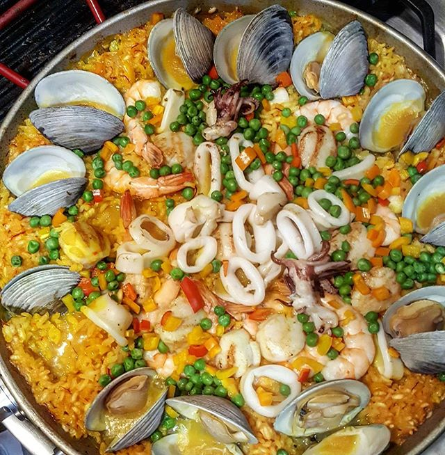 Dinner is served. . . . #notjustpizza #chefcarl #onebro #paella #seafood #cooking #sundayfunday #footballsunday